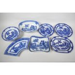 Seven pieces of C19th blue and white pottery, 'Boy on a Buffalo' pattern, to include a shaped