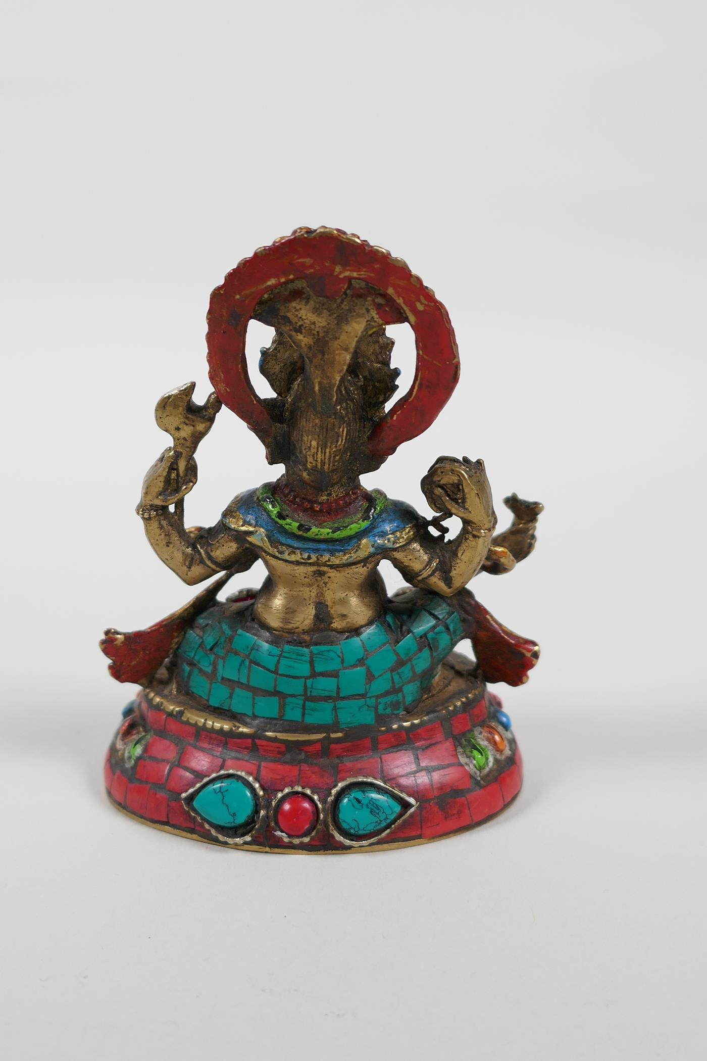 An Indian brass figure of Ganesh with painted highlights and set with semi precious stones, mark - Image 2 of 4