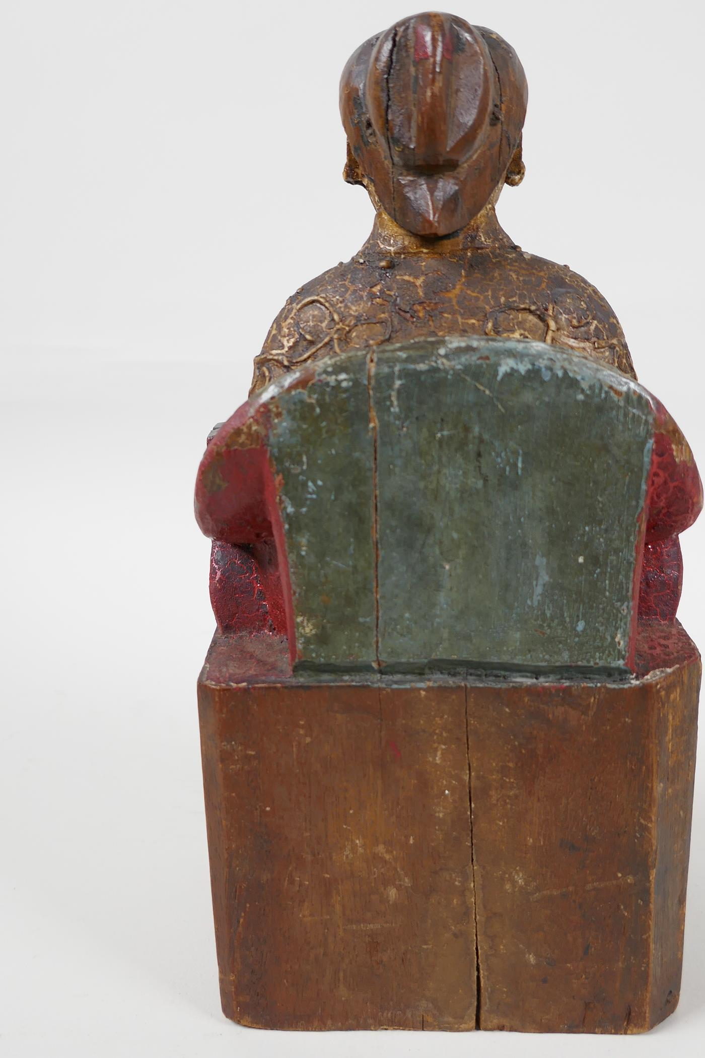 """A Chinese carved wood figure of a dignitary seated on a throne, traces of paint, 9"""" high - Image 4 of 6"""
