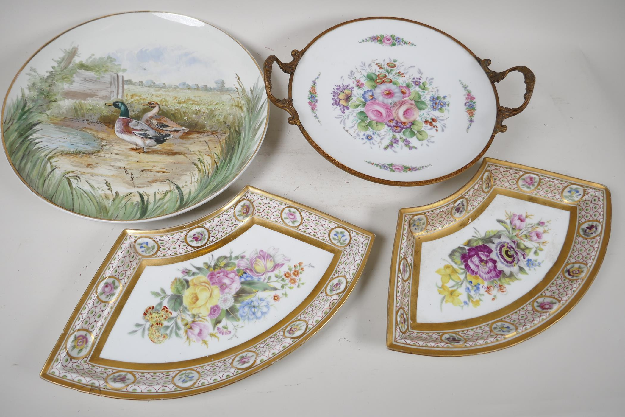 """A continental porcelain and ormolu tazza painted with flowers, 9½"""" diameter, together with a pair of"""
