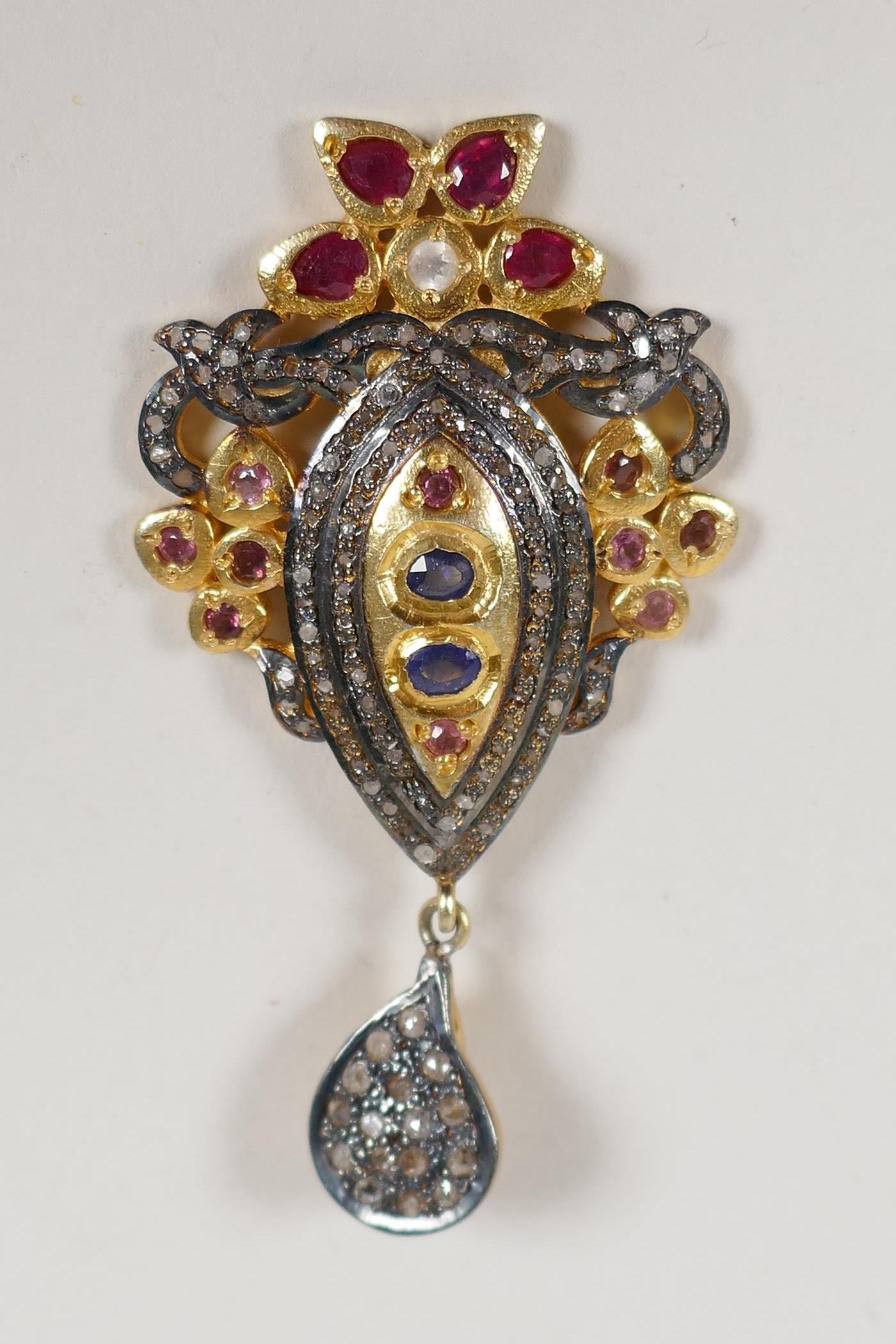 "A silver gilt pendant set with uncut diamonds, rubies and sapphire, en suite to previous lot, 2"""