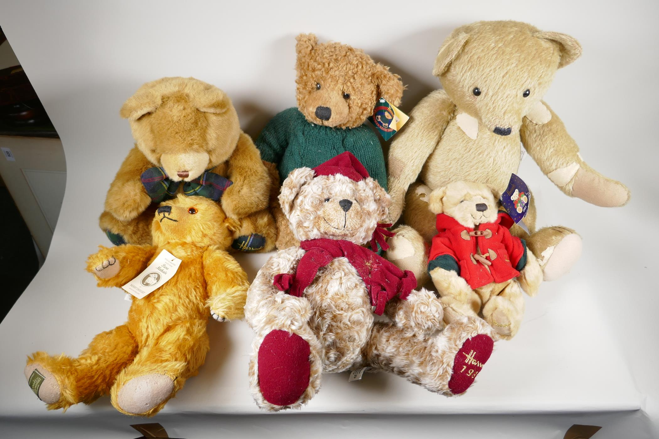 """A vintage 'House of Nisbet' teddy bear (patched) 22"""" long, four Harrods bears, 1994, 1998, 1999"""