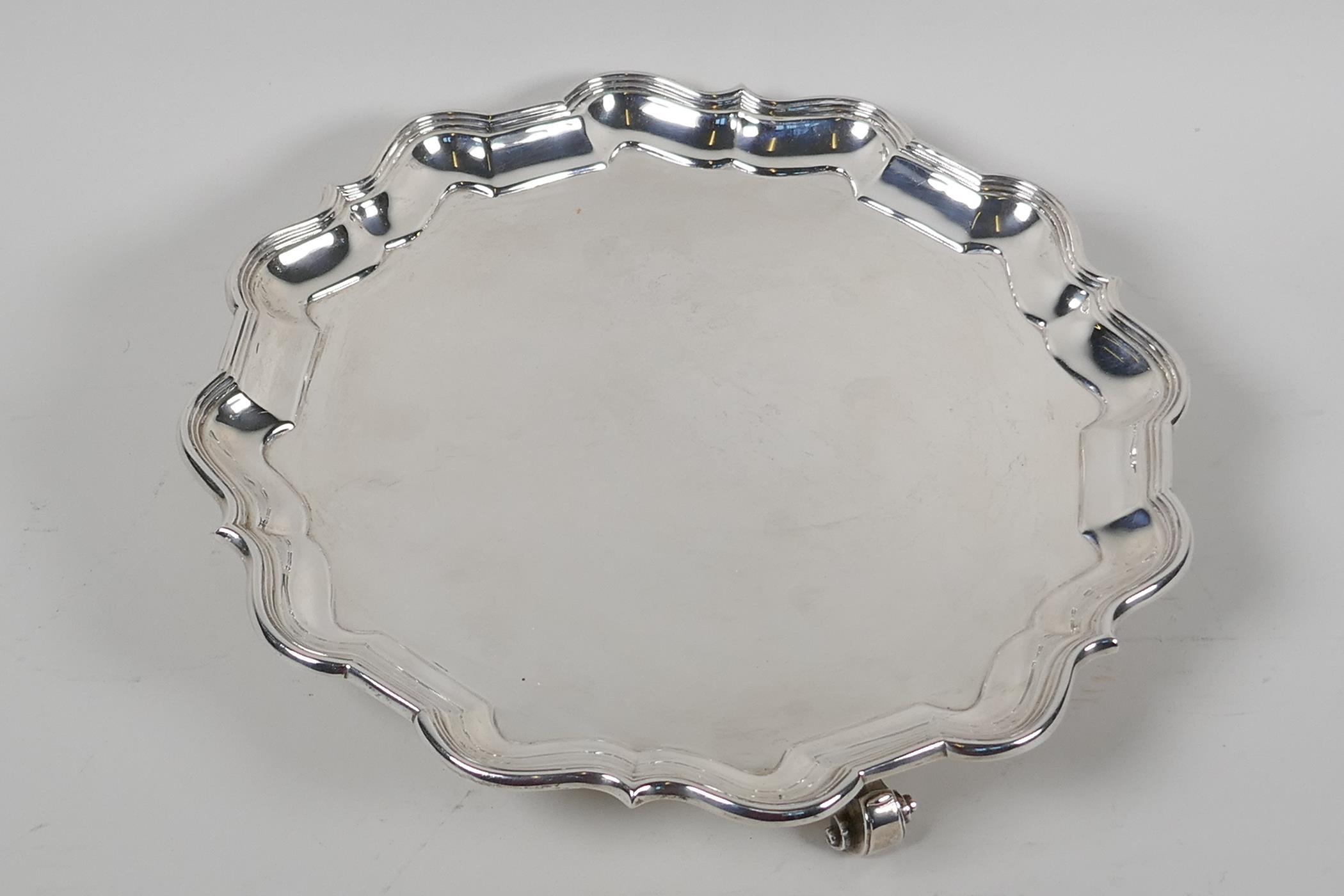 A hallmarked silver serving tray with gadrooned rim, on three cast scroll supports, hallmarked - Image 2 of 5