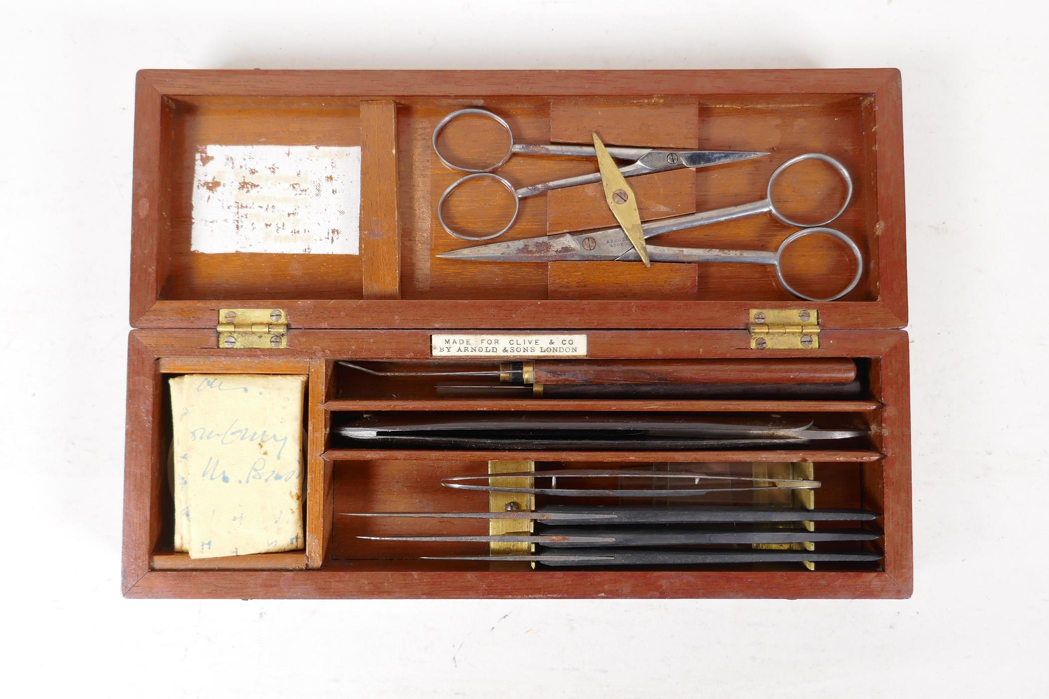 A field surgeons kit by Arnold & Sons, London, for Clive & Co, containing scalpels, a cut throat,