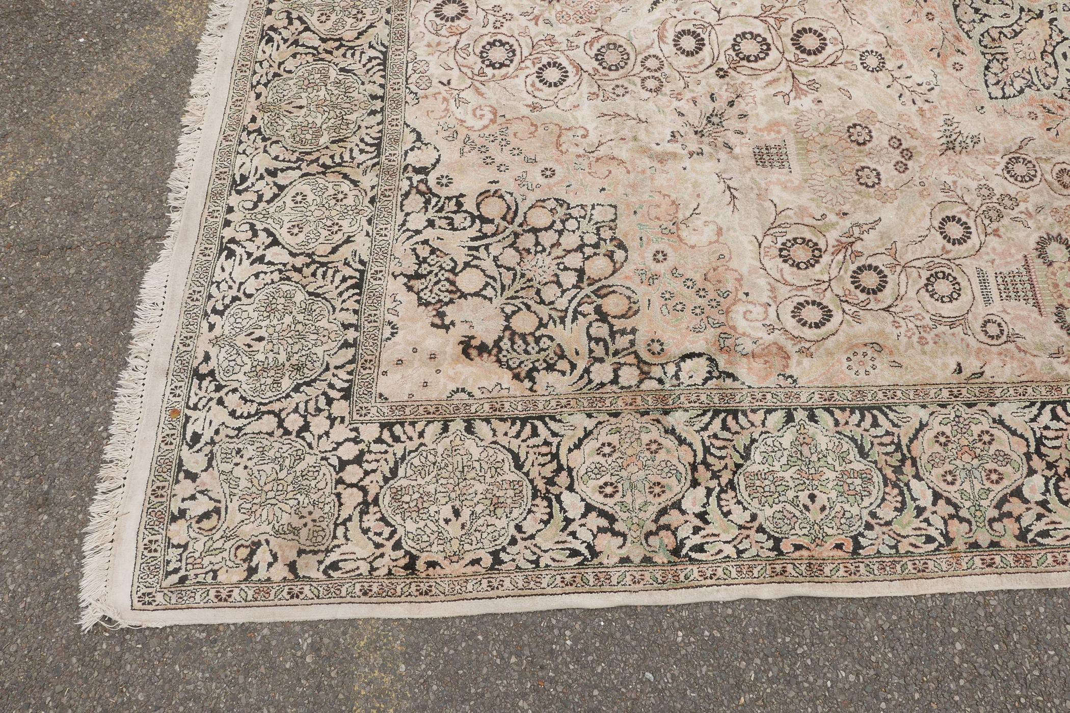 """An oriental ivory ground silk carpet, with multicolour floral decoration within a black border, 151"""" - Image 5 of 6"""
