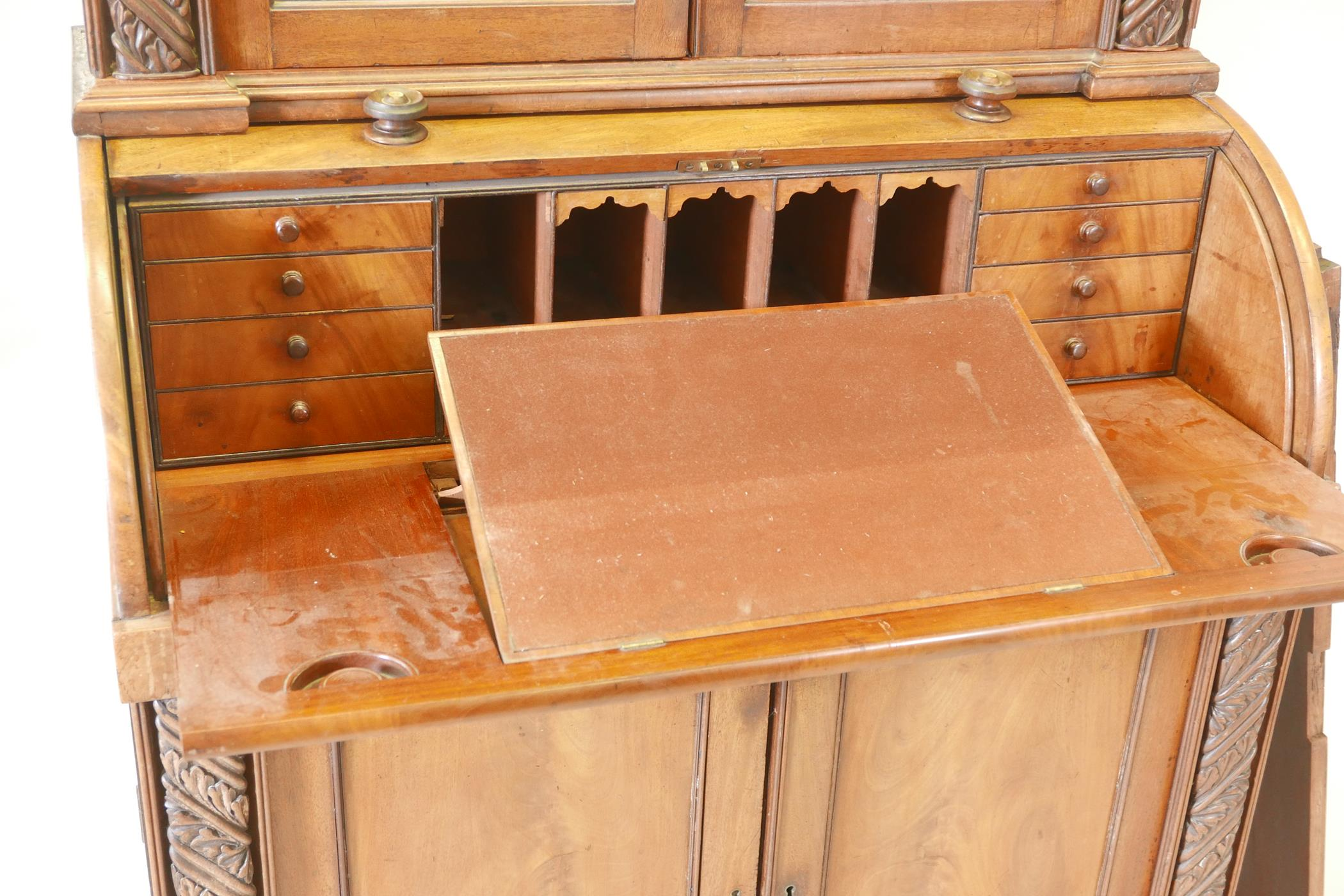 A Victorian cylinder top bureau bookcase, the upper section with two glazed doors and carved - Image 5 of 6