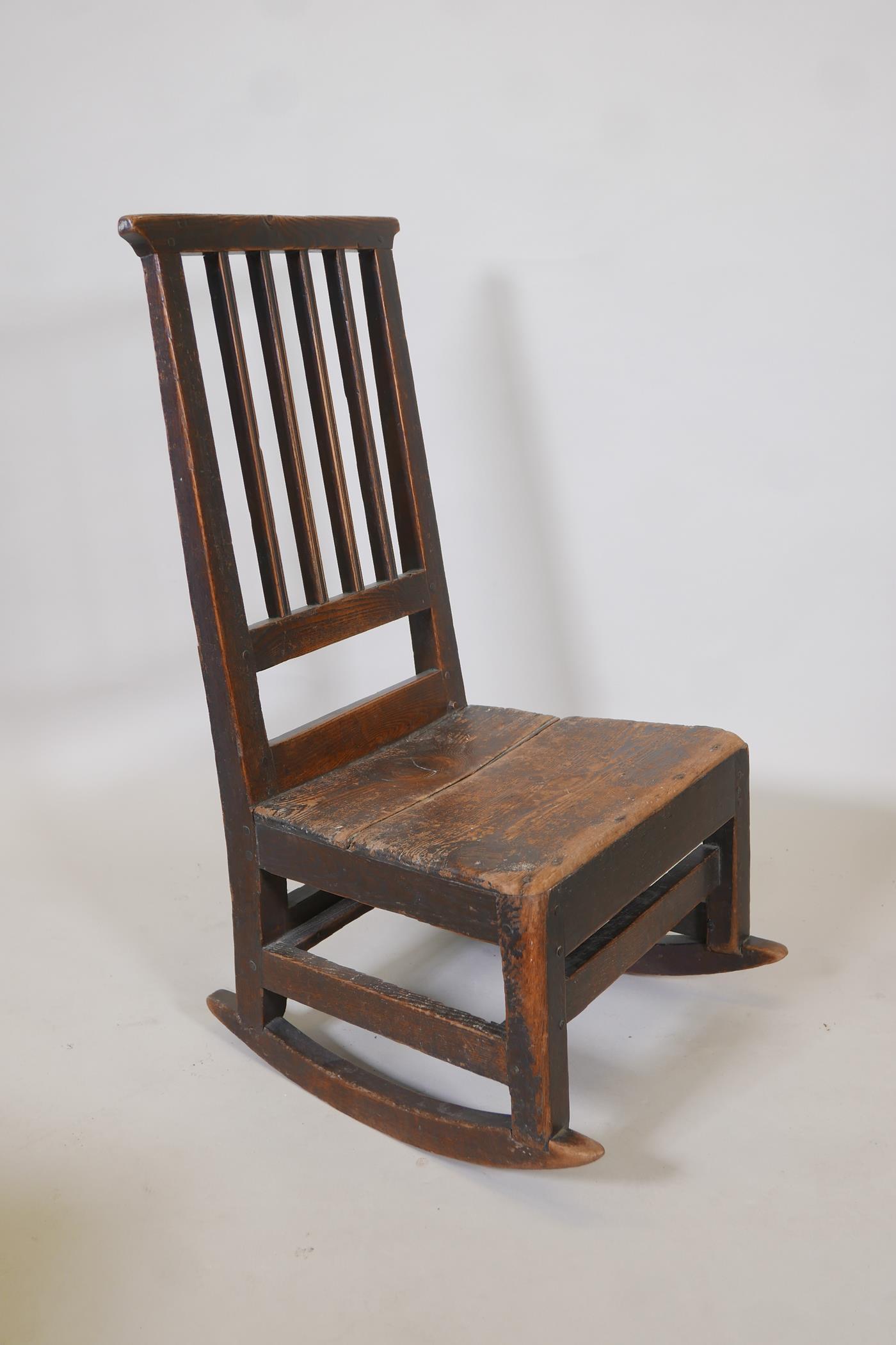 An C18th elm ladderback rocking chair