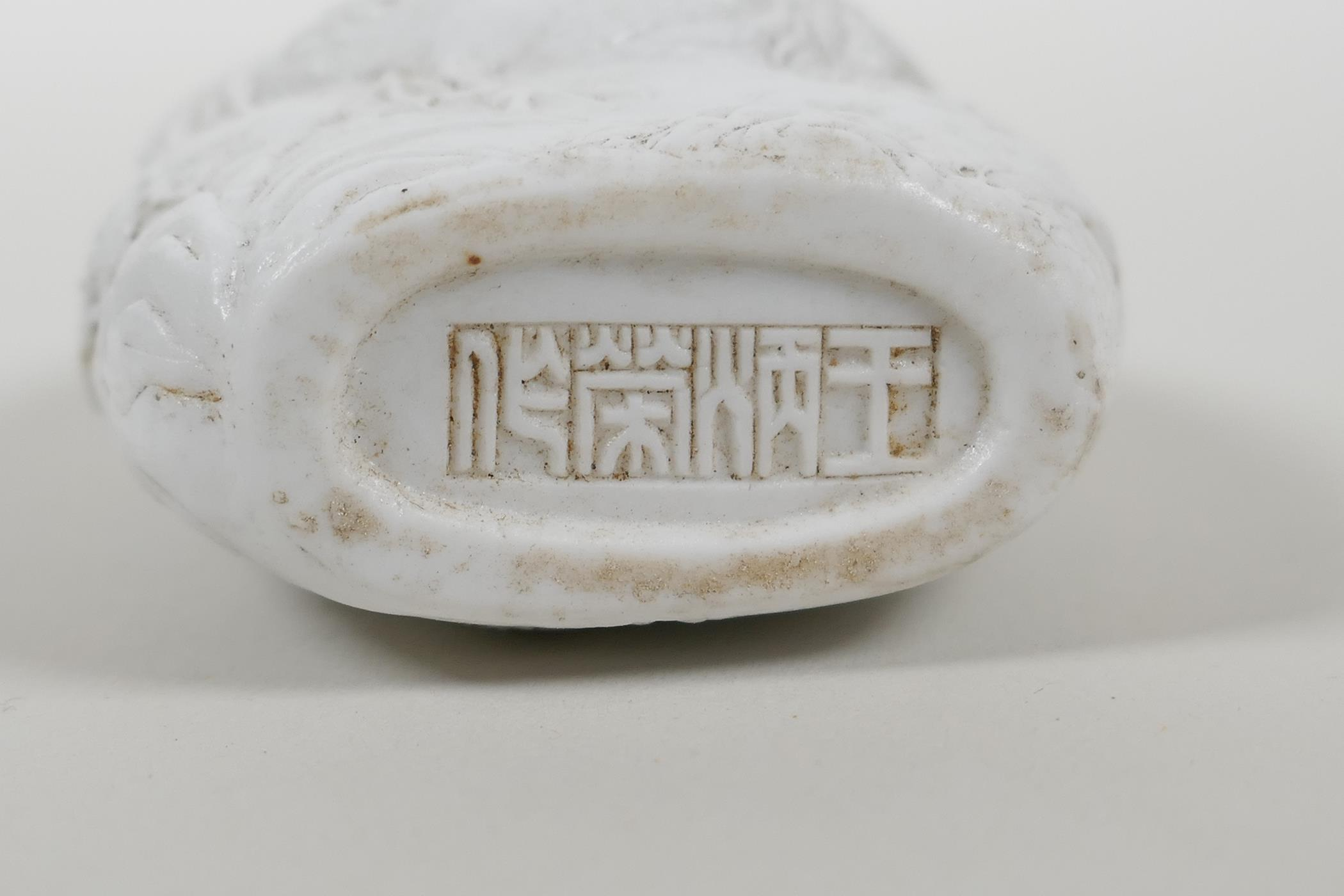 A Chinese hard paste snuff bottle with moulded cockerel decoration, impressed seal mark to base, - Image 3 of 3