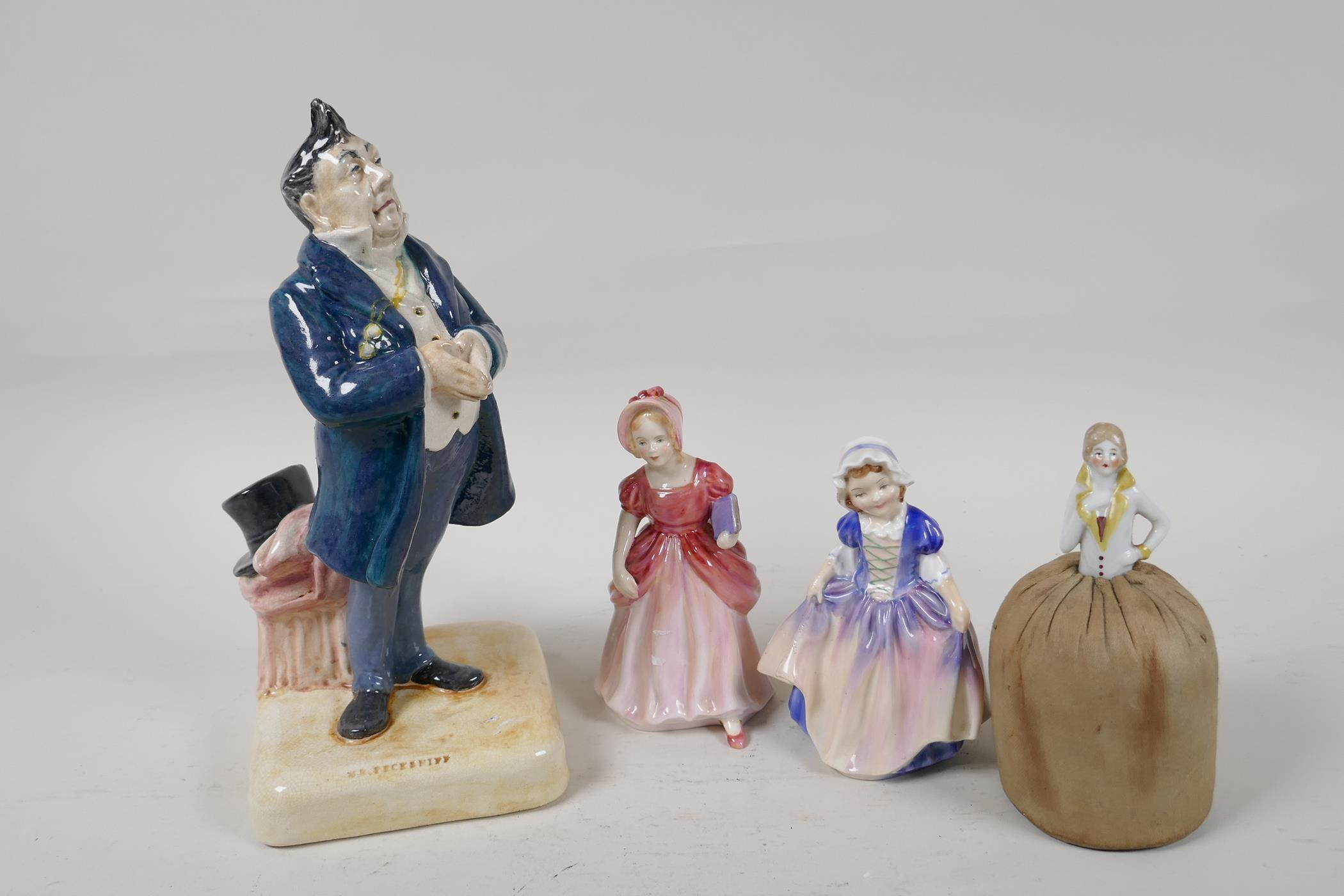 """A Bretby Pottery Dickens character, 'Mr Pecksniff', 9"""" high, together with a Paragon pottery figure,"""