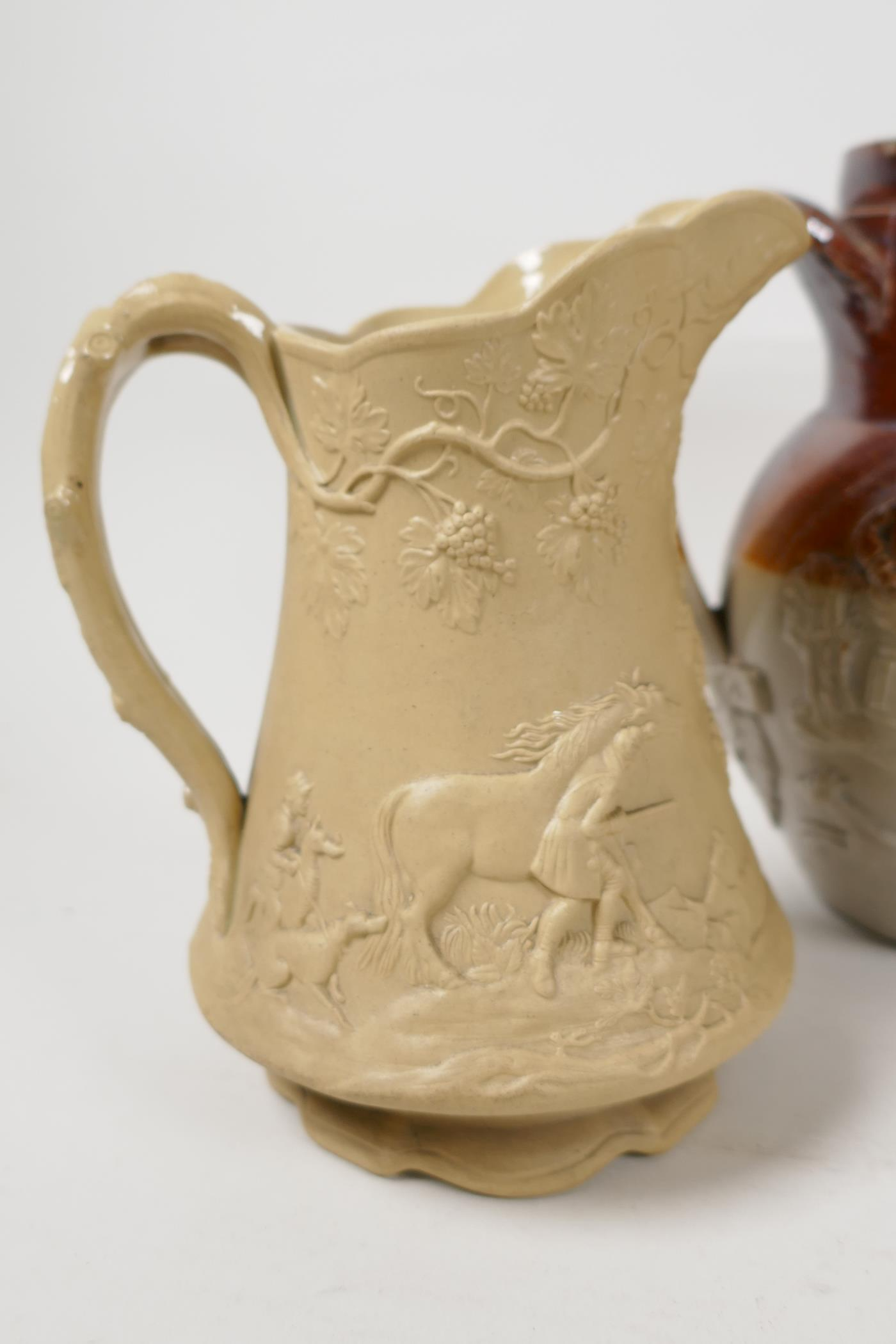 """A C19th pottery jug embossed with hunting figures and fruiting grape vine, lozenge mark to base, 5½"""" - Image 2 of 8"""