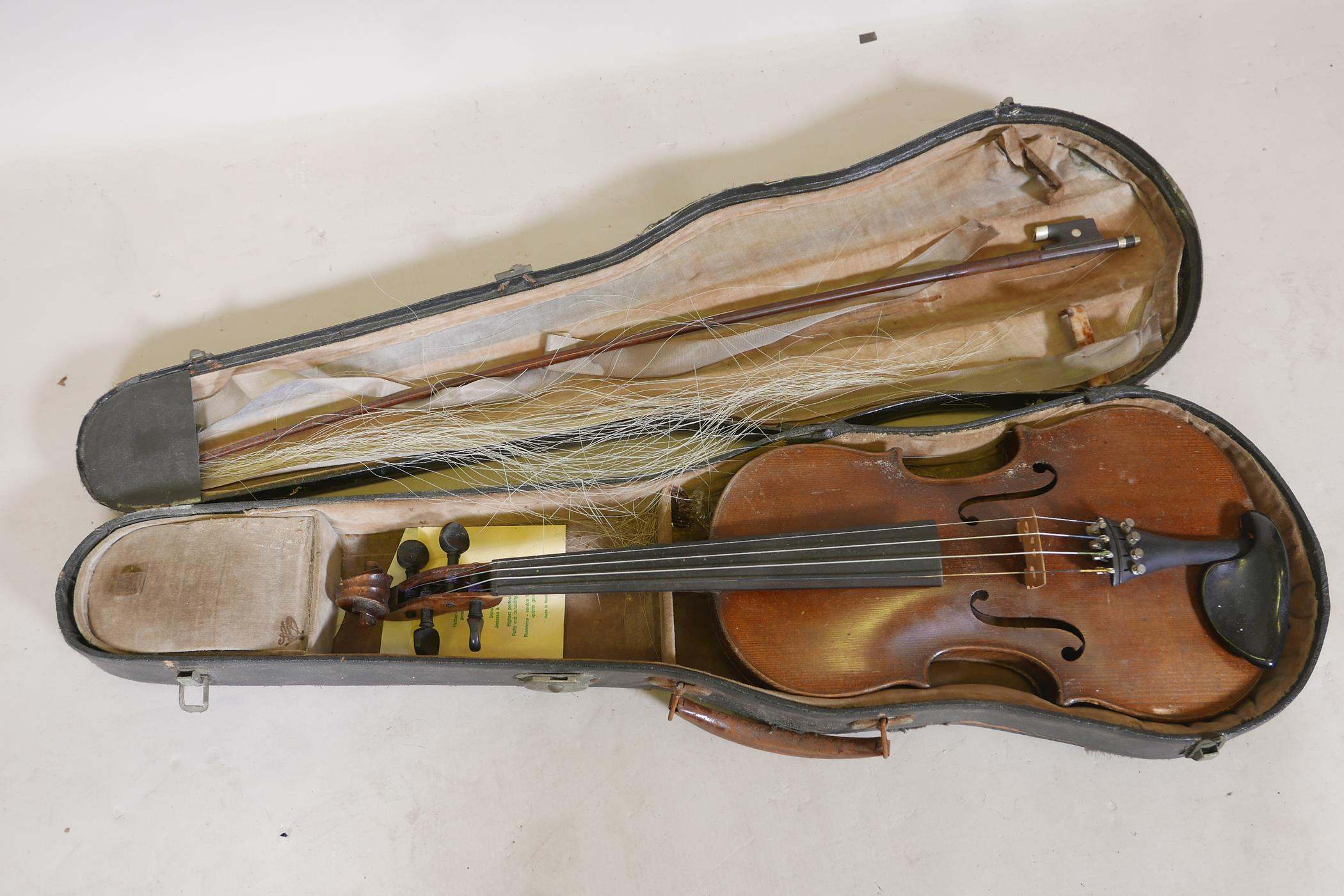 """A vintage violin and bow in case, 14½"""" back including button, 23½"""" long"""