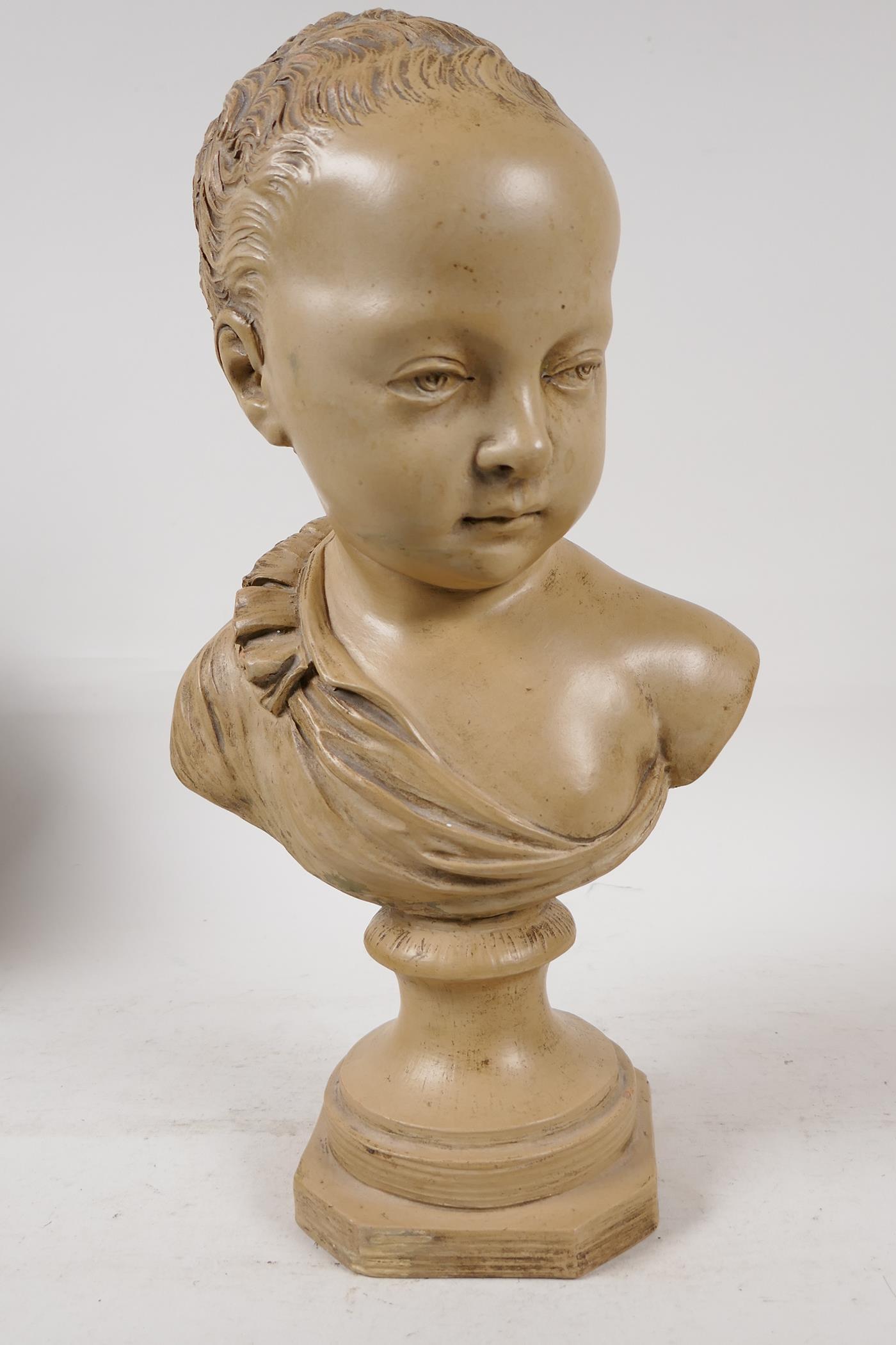 "A terracotta bust of a chld, after J.A. Houdon, 13"" high"