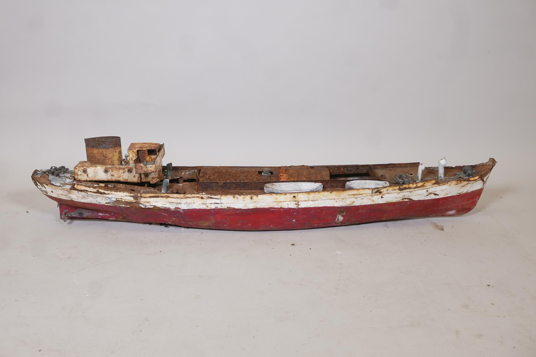 """A late C19th/early C20th scratch built painted iron steam boat, A/F, 44"""" long"""