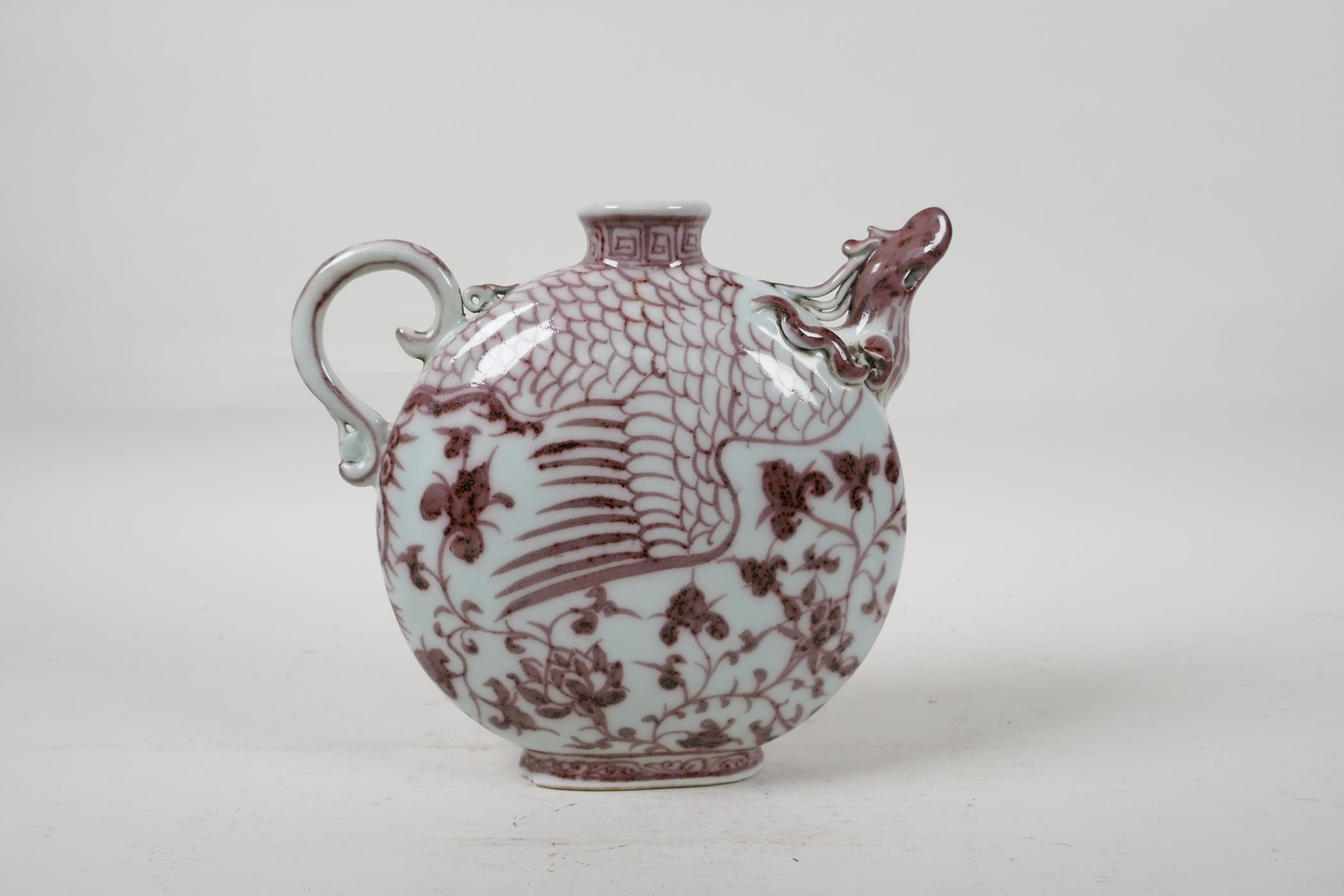 """A Chinese red and white porcelain phoenix pourer, 7"""" high"""
