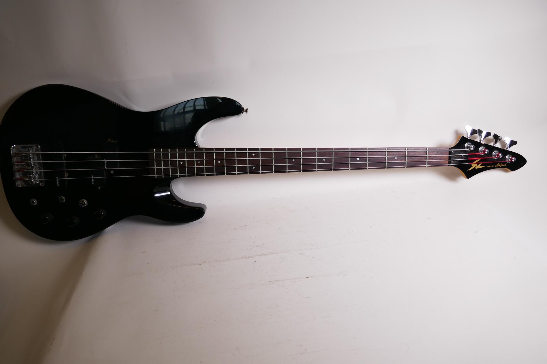 "An Aria Pro II bass guitar with three Aria II pick ups, 45"" long"