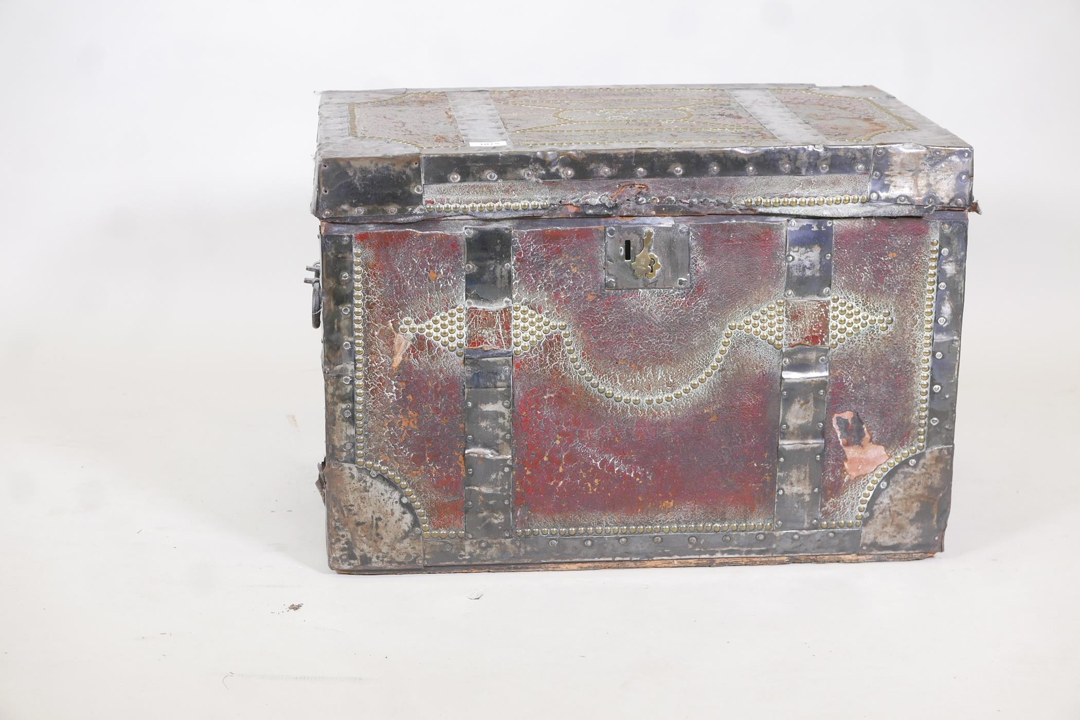 An early C19th painted leather trunk with brass stud decoration and steel straps, original papered - Image 2 of 5