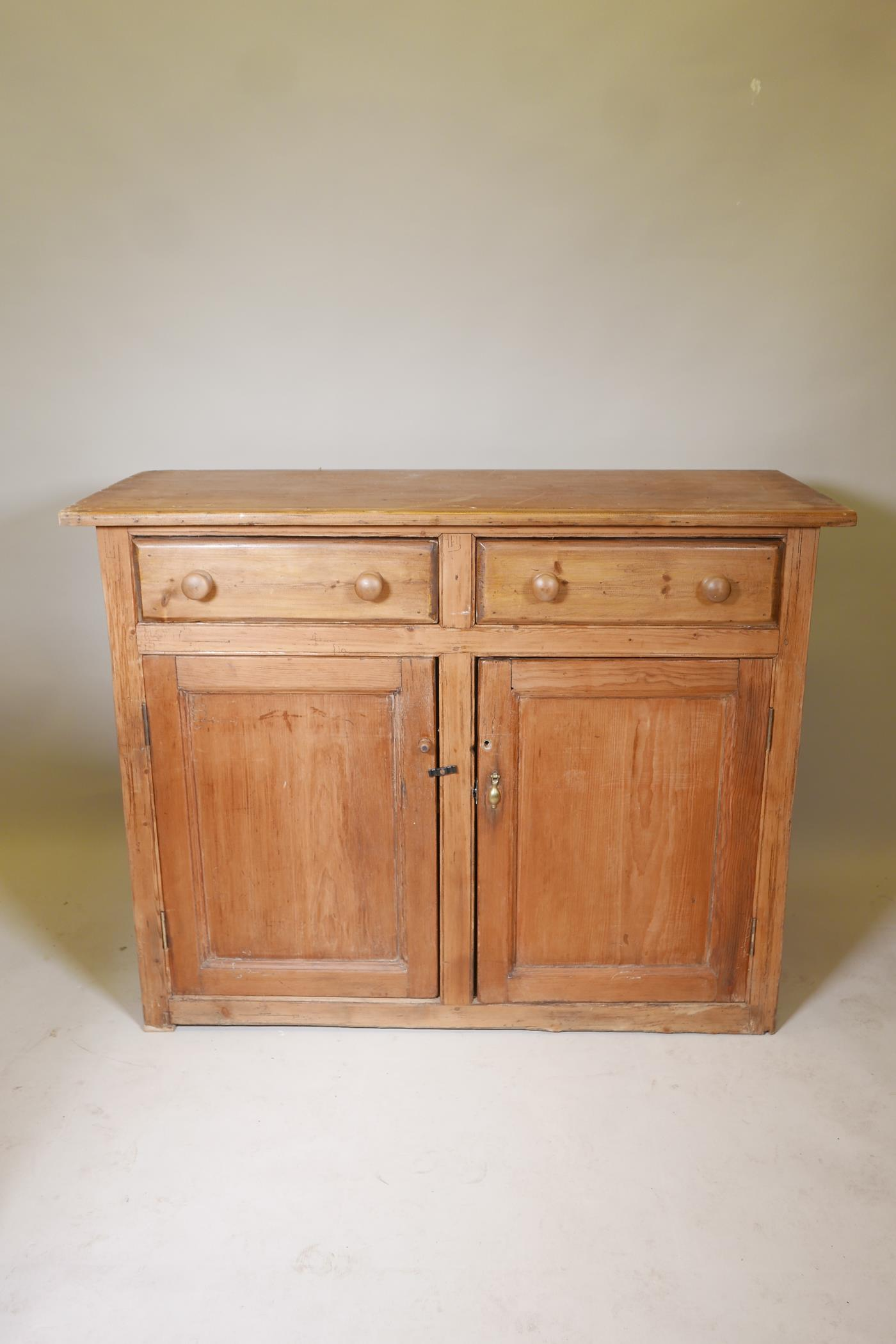 """A C19th pine buffet of two drawers over two cupboards, 52"""" x 21"""", 39"""" high"""