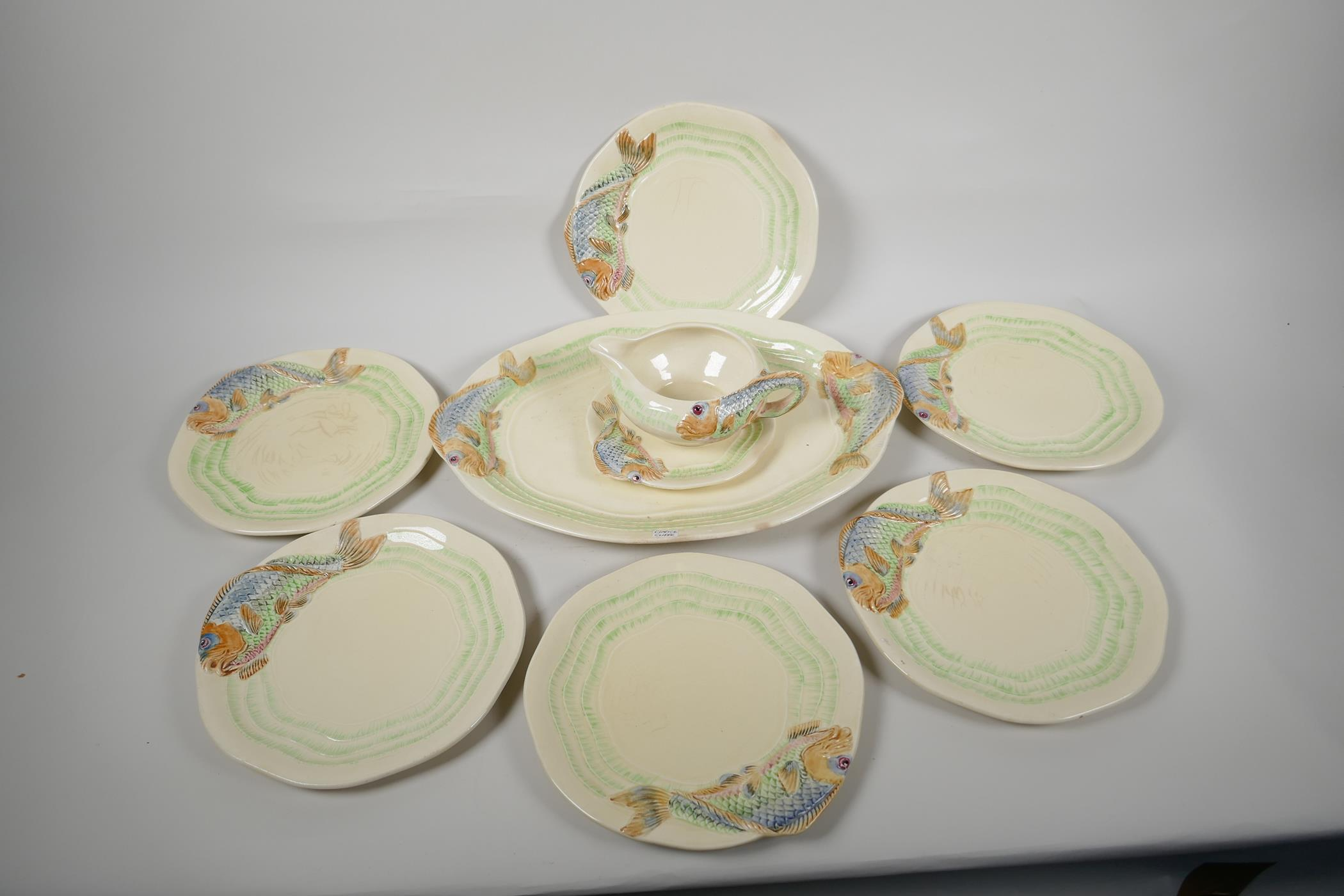 """Clarice Cliff for Wilkinson, a nine piece fish service, serving plate 15"""" x 10"""", six 8½"""" plates,"""
