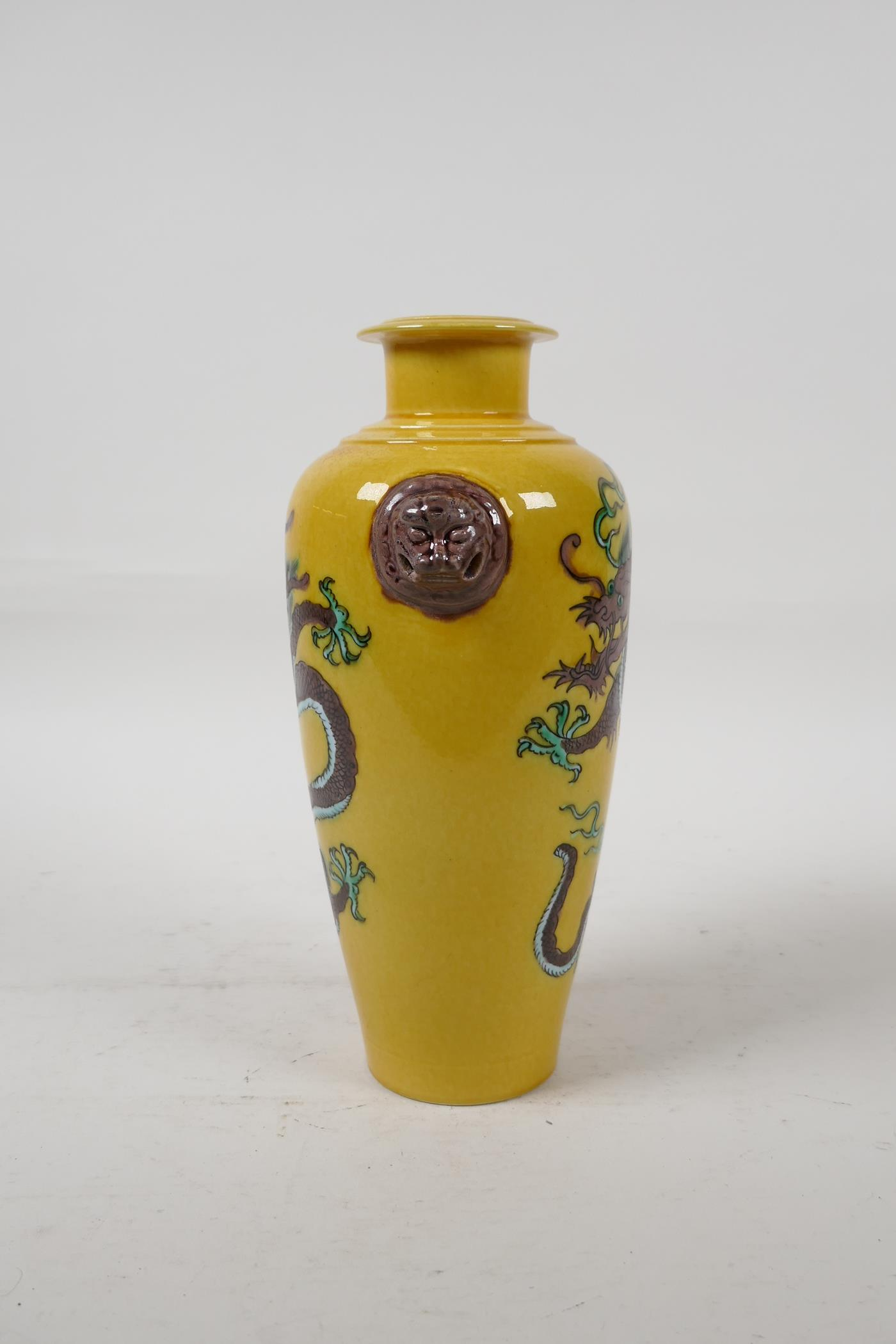 A Chinese Sancai glazed porcelain vase with two lion mask handles and dragon decoration, six - Image 4 of 5