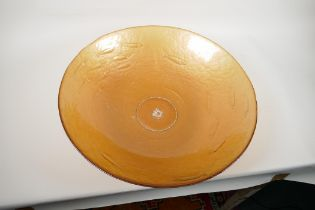 """A large amber glass centrepiece bowl, embossed with a shoal of fish, 19"""" diameter"""