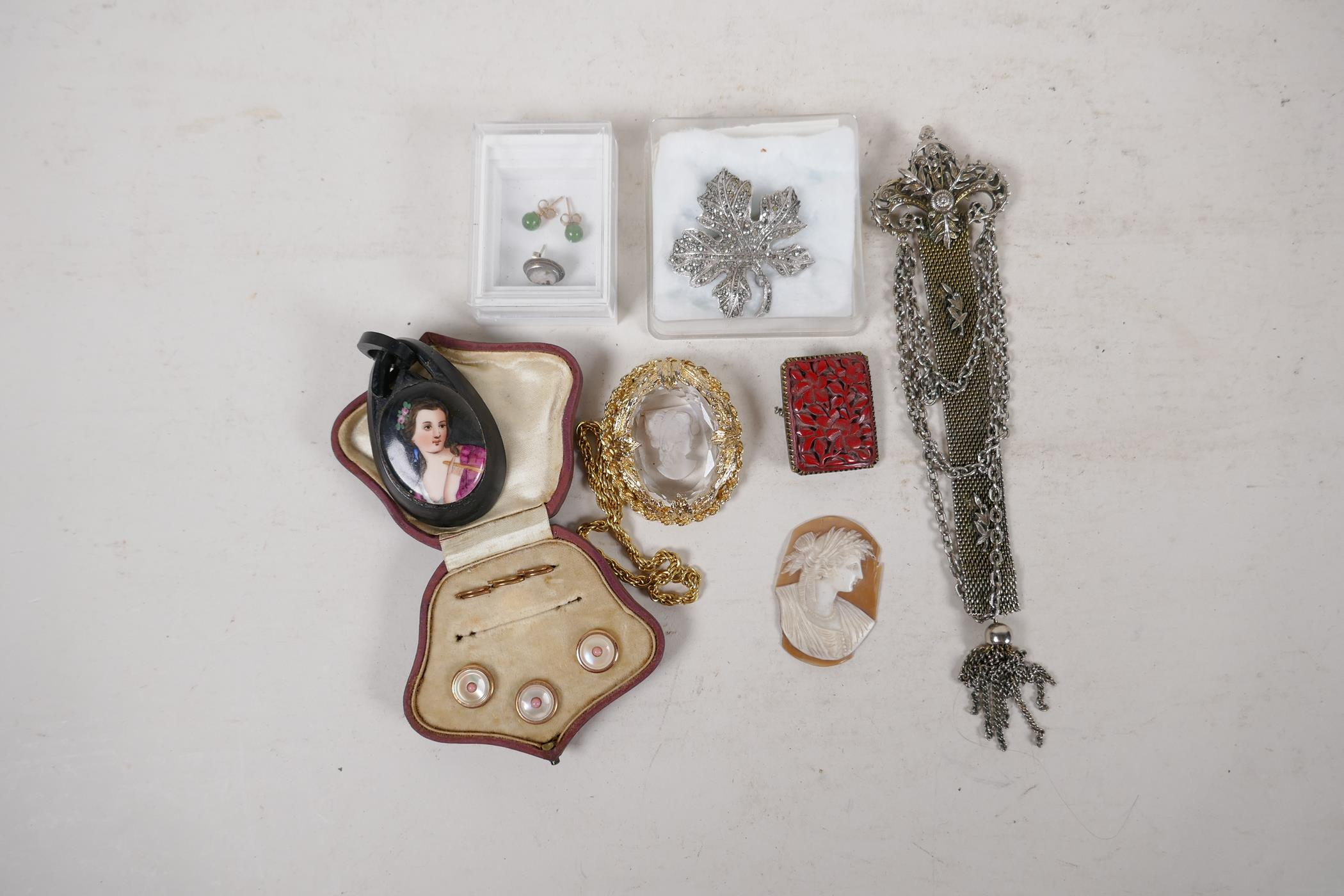 A pair of silver gilt and jade bead stud earrings, an unmarked white metal chain pendant brooch, a