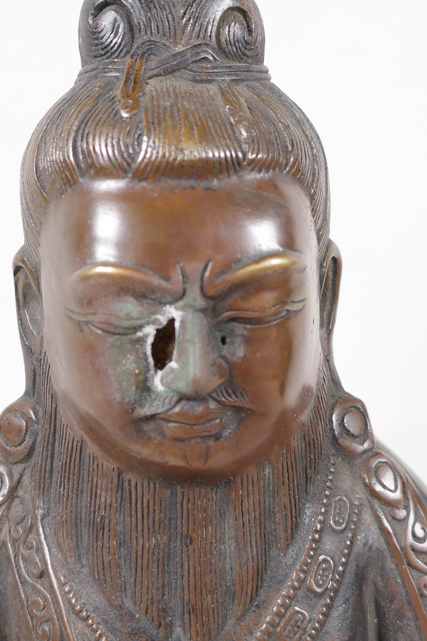 """A Sino Tibetan bronze figure of a deity seated in meditation, 11½"""" high - Image 2 of 4"""