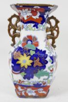 A two handled pottery vase, painted with flowers in the Chinese manner, blue seal mark to base,
