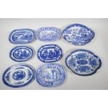 Eight C19th blue and white pottery dishes, various patterns to include the Long Bridge, Boy on a