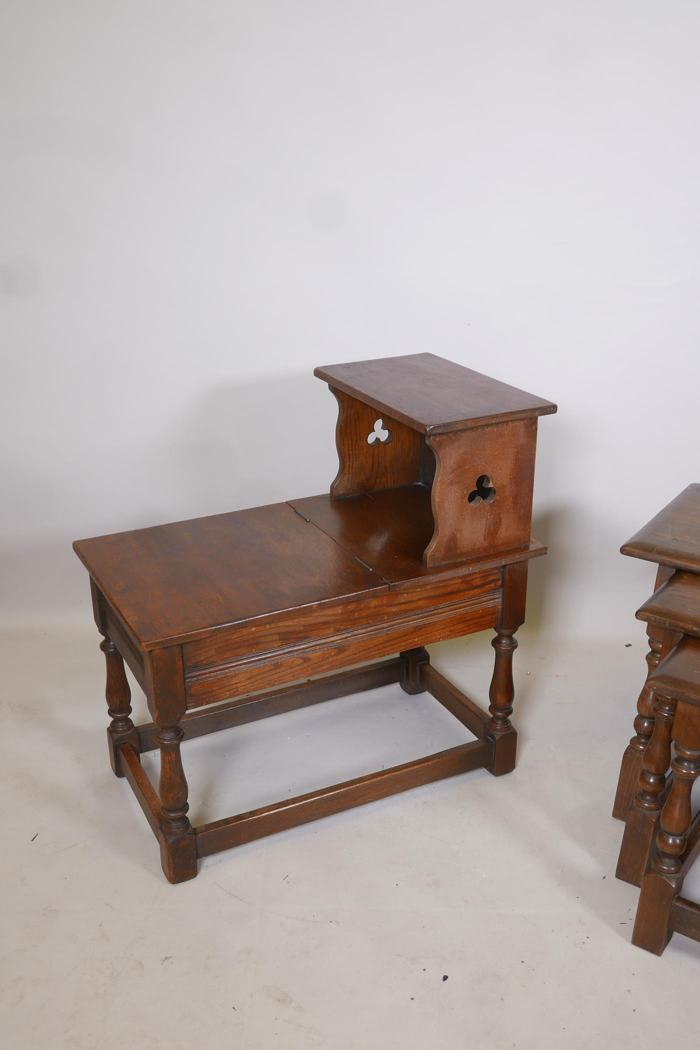 A nest of three oak tables on turned and splayed supports, together with an oak telephone table, - Image 3 of 3