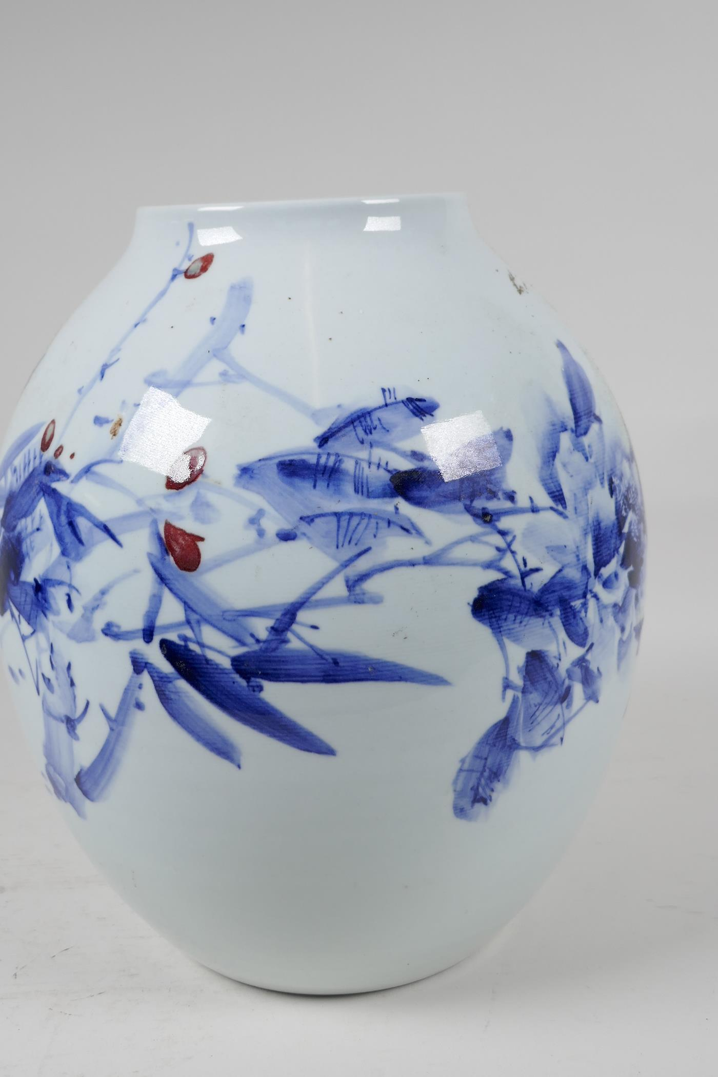 A Japanese porcelain vase decorated with stylised flowers in blue and red with character - Image 5 of 5