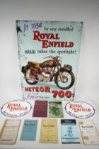 A replica Royal Enfield metal advertising sign, two painted cast iron wall plaques and a