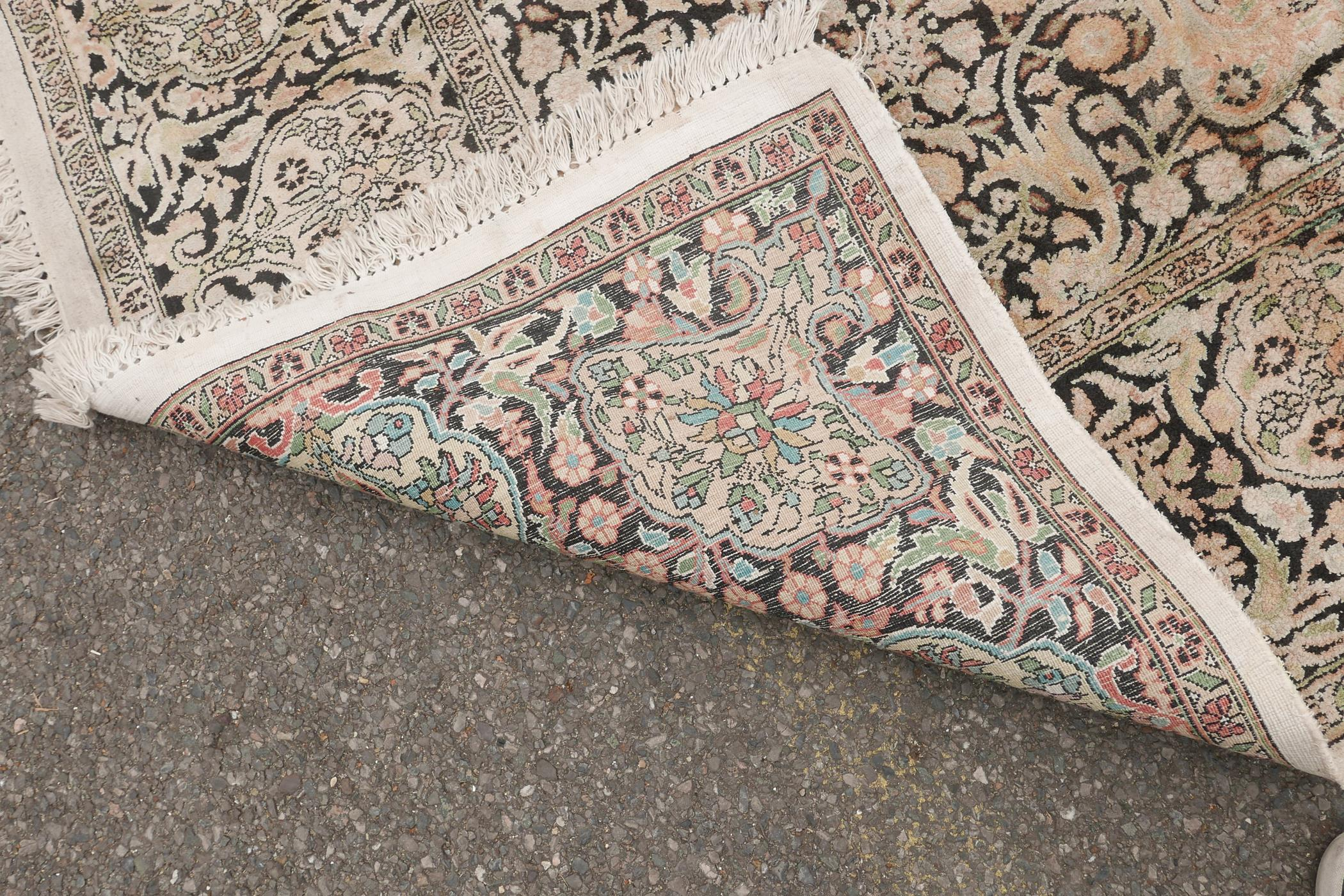 """An oriental ivory ground silk carpet, with multicolour floral decoration within a black border, 151"""" - Image 6 of 6"""