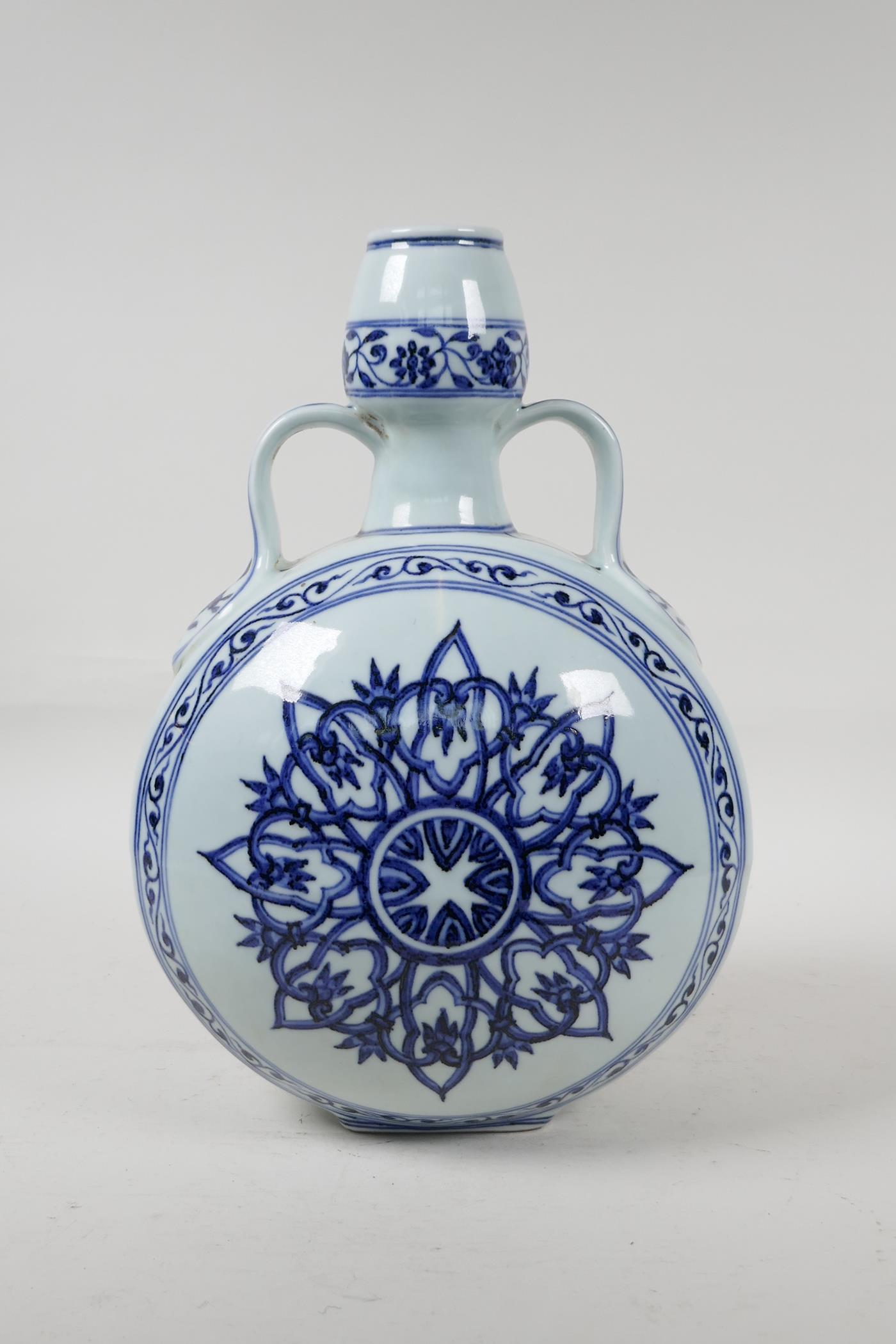 A blue and white porcelain garlic head shaped flask with two handles and YinYang decoration, six - Image 3 of 6