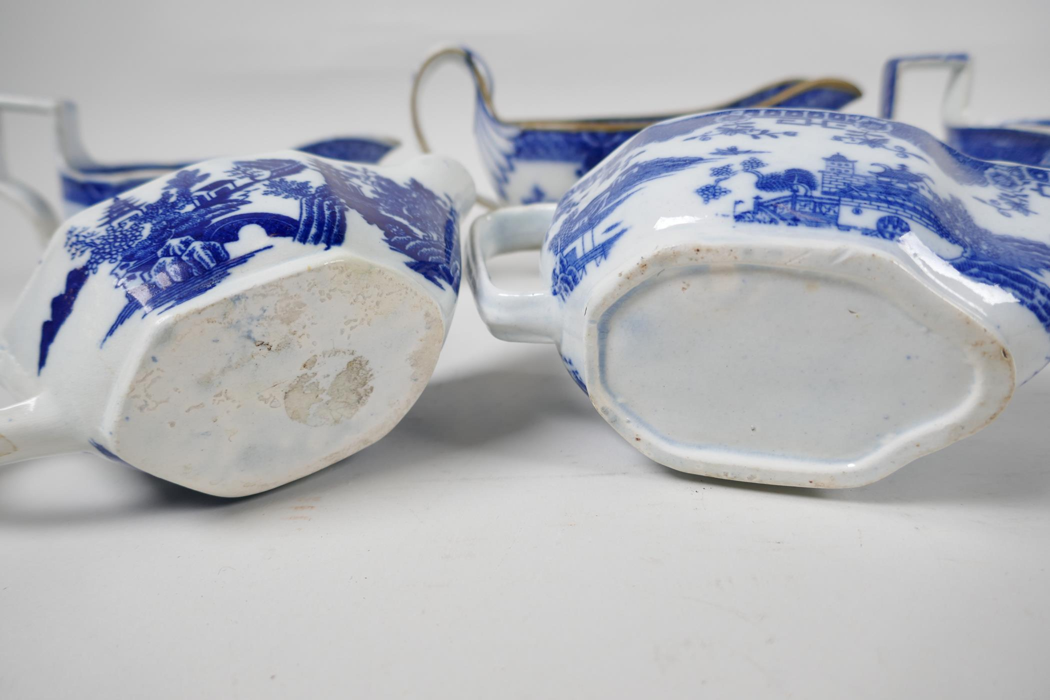 Five late C18th/early C19th English blue and white pottery sauce boats to include Boy on a Buffalo - Image 7 of 9