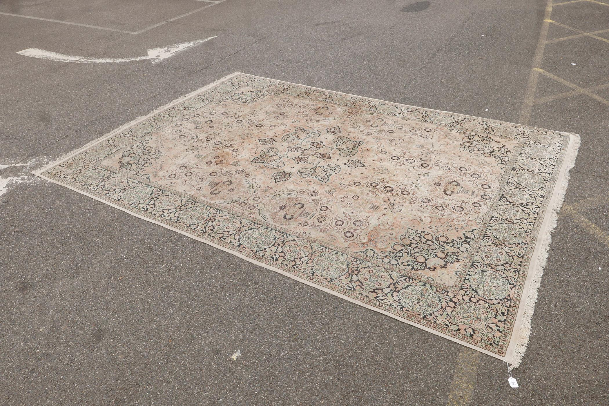 """An oriental ivory ground silk carpet, with multicolour floral decoration within a black border, 151"""" - Image 2 of 6"""