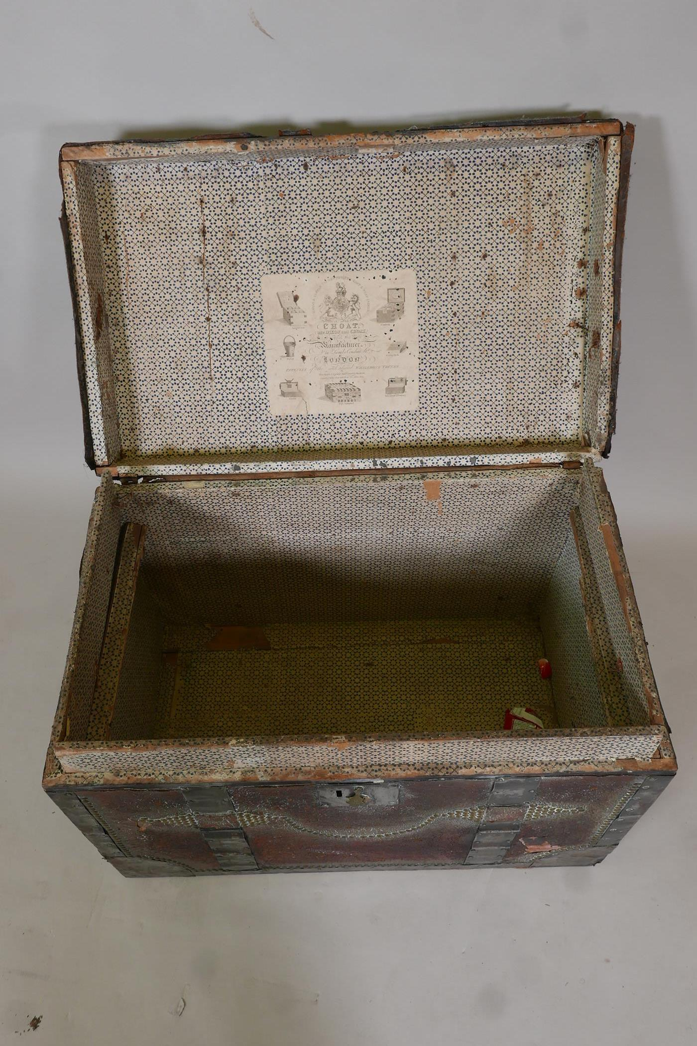 An early C19th painted leather trunk with brass stud decoration and steel straps, original papered - Image 5 of 5
