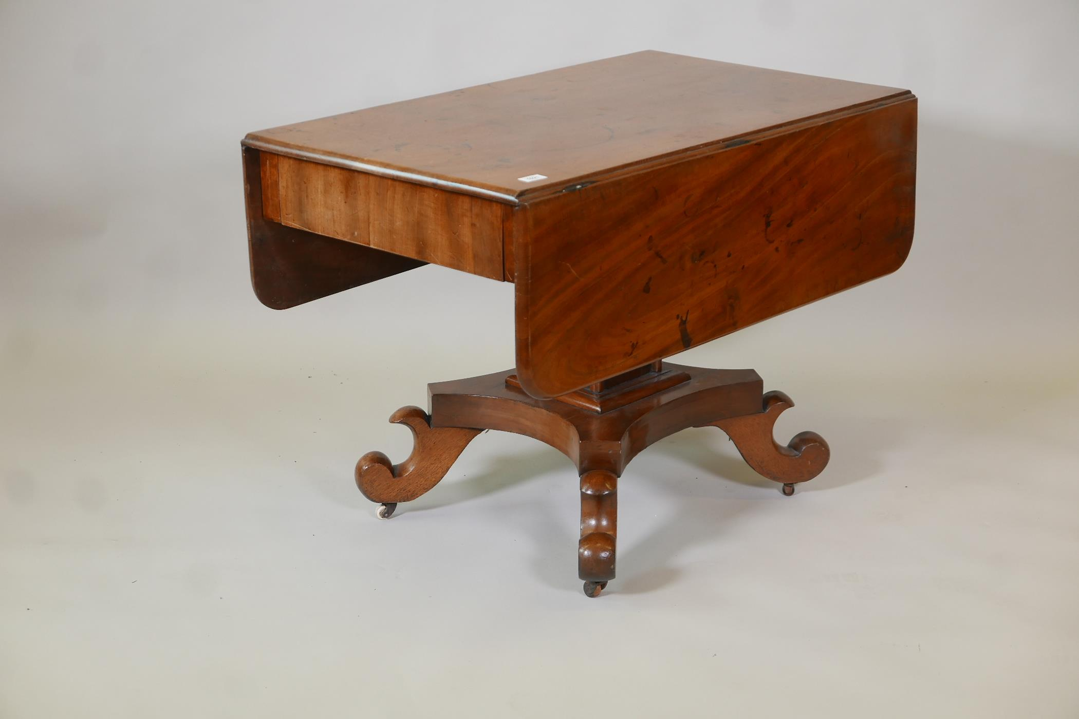 A C19th Continental mahogany sofa table with single end frieze drawer, raised on a square column and