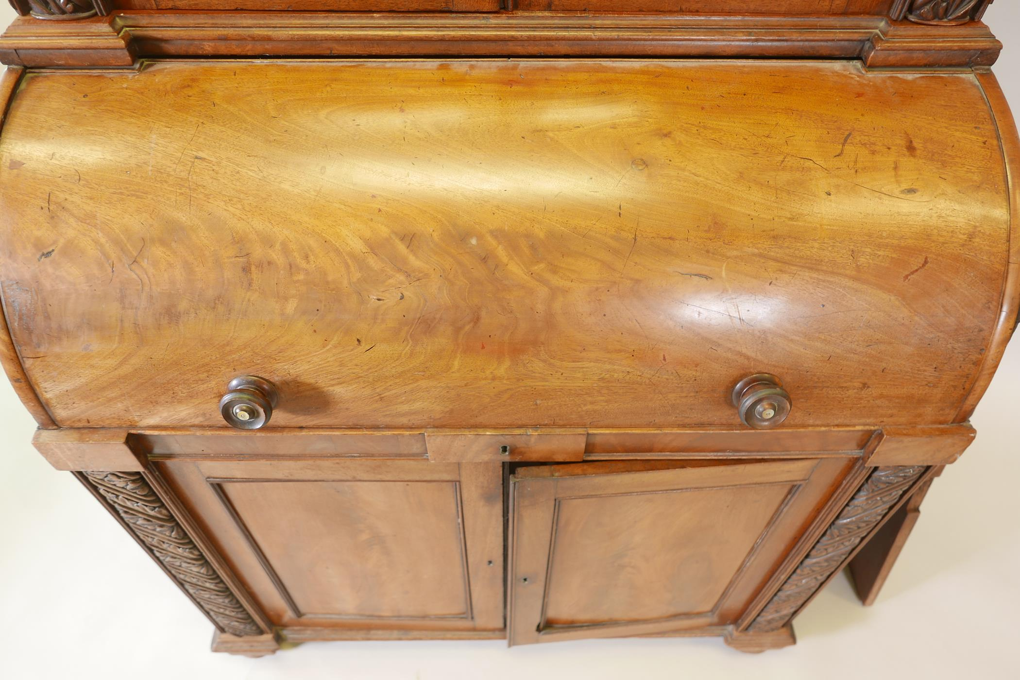 A Victorian cylinder top bureau bookcase, the upper section with two glazed doors and carved - Image 2 of 6