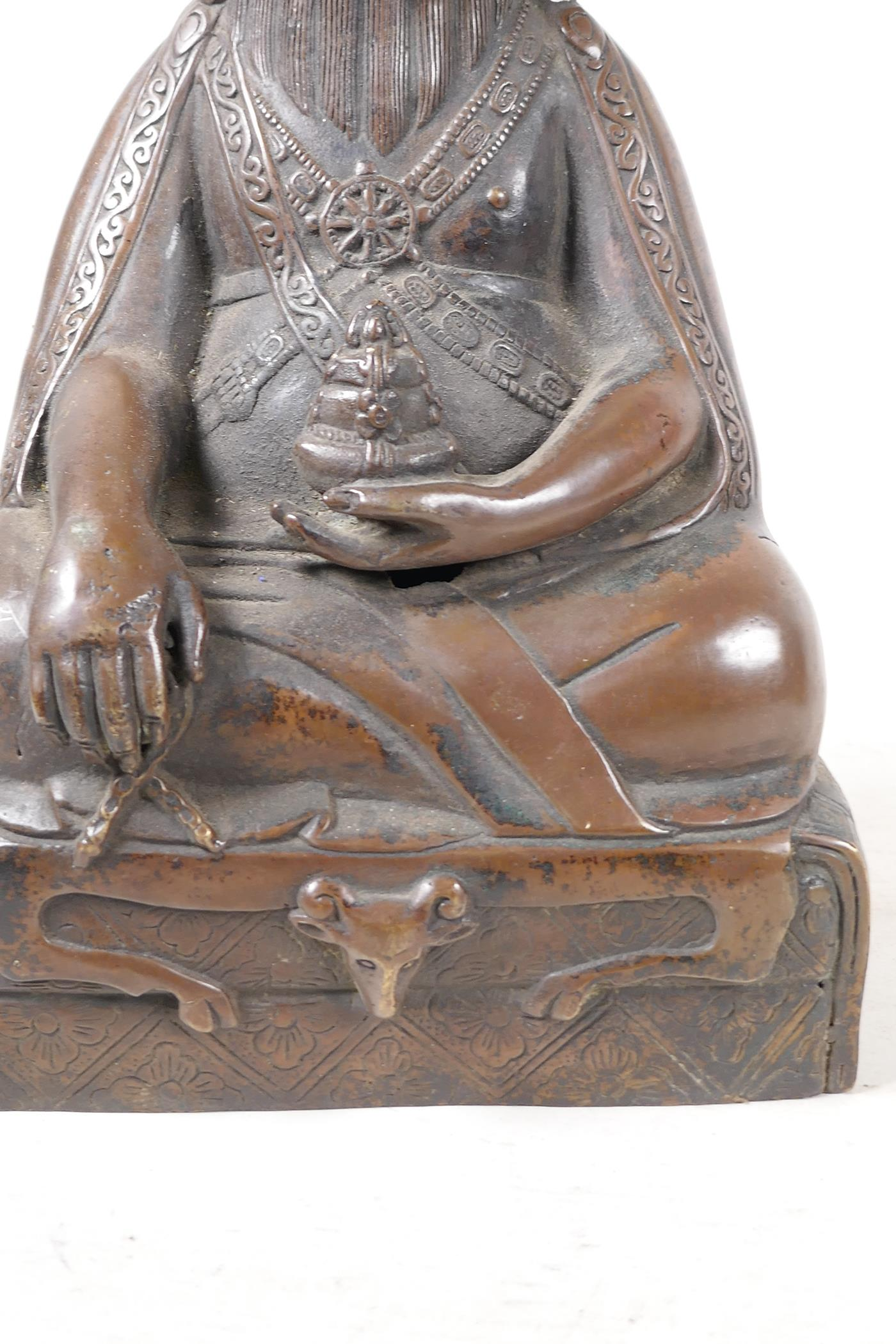 """A Sino Tibetan bronze figure of a deity seated in meditation, 11½"""" high - Image 4 of 4"""