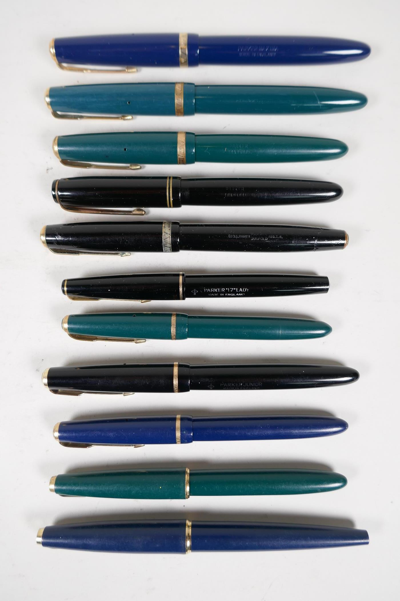An assortment of Parker fountain pens, including two 'Maxima Duofold', three 'Duofold', two 'lady'