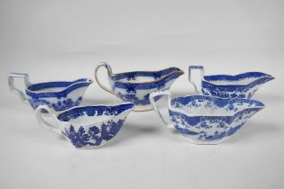 Five late C18th/early C19th English blue and white pottery sauce boats to include Boy on a Buffalo