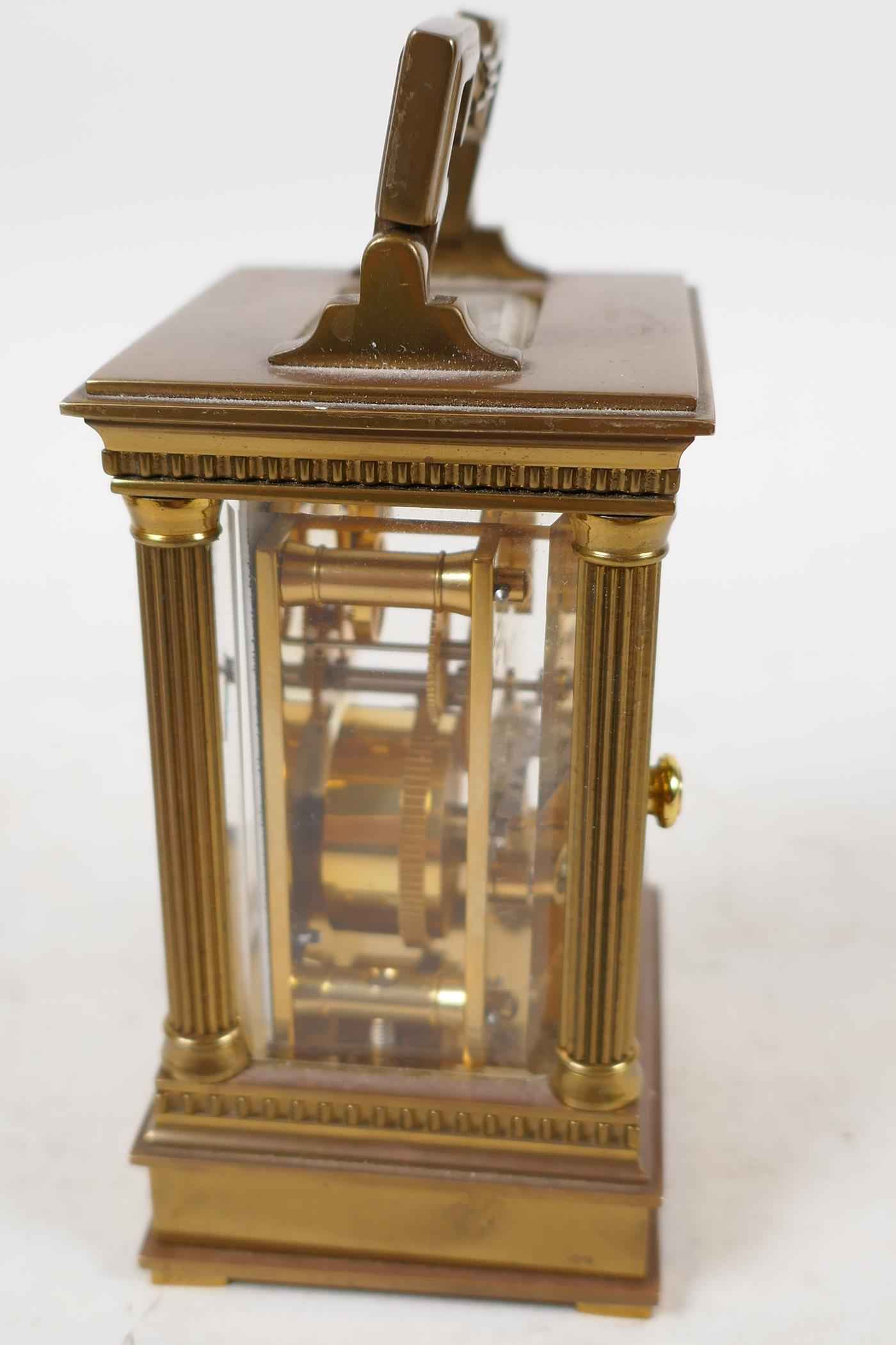 A Swiss made carriage clock in brass case with reeded columns, white enamel dial and Roman numerals, - Image 2 of 4