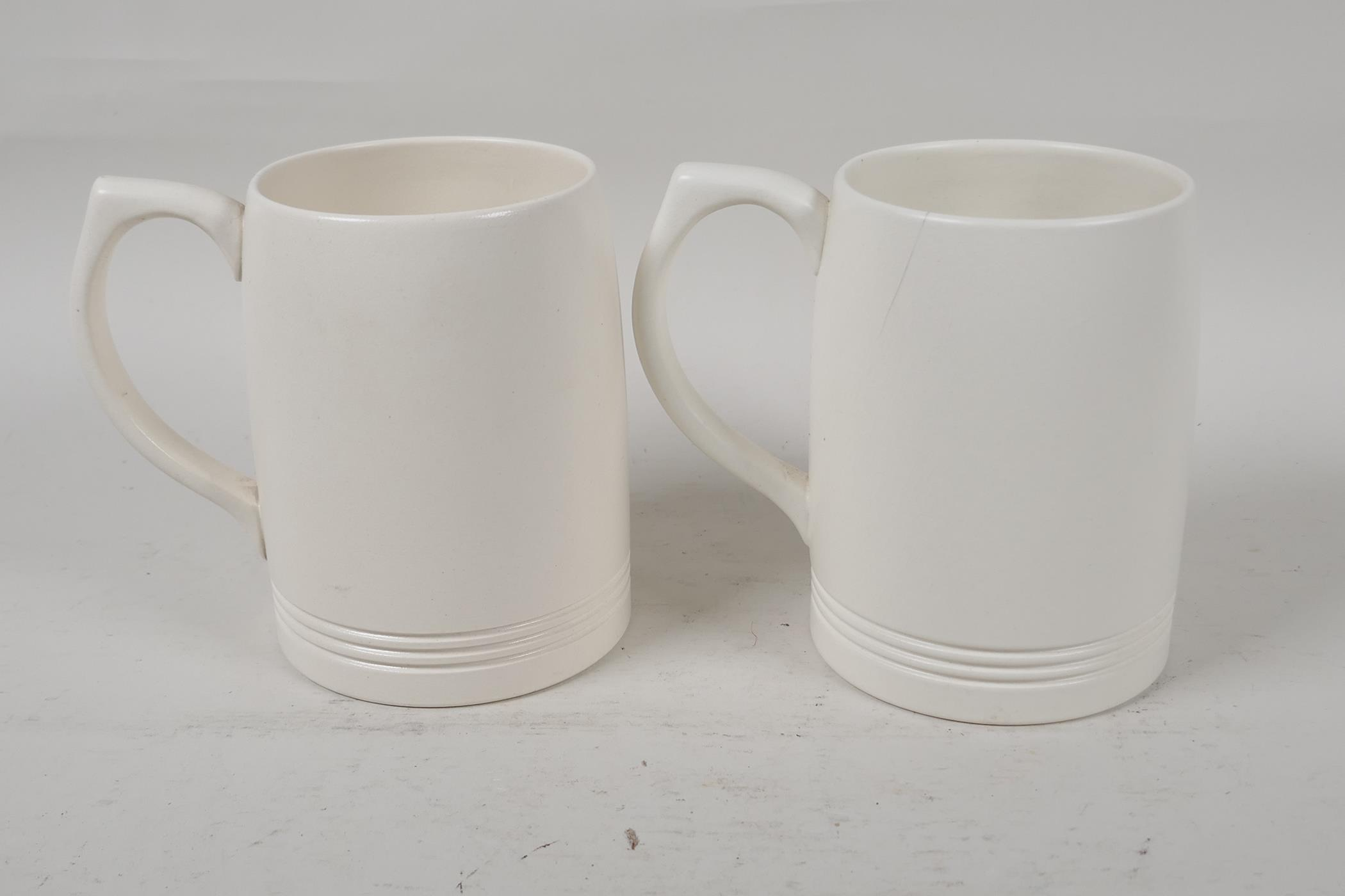 """Two Wedgwood Keith Murray tankards, 4½"""" high"""