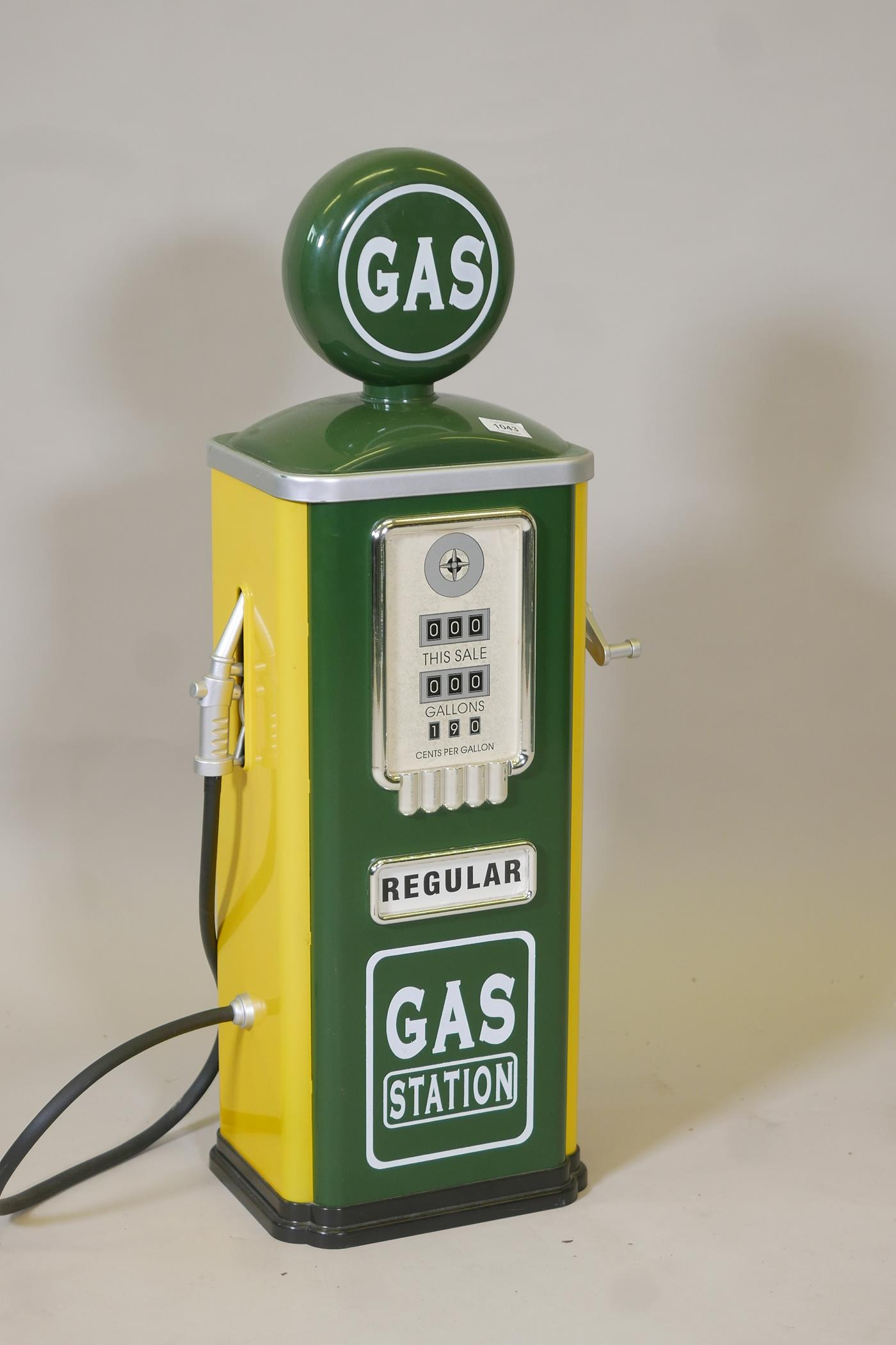 """A child's 'gas' pump in racing green and yellow, 31½"""" high"""