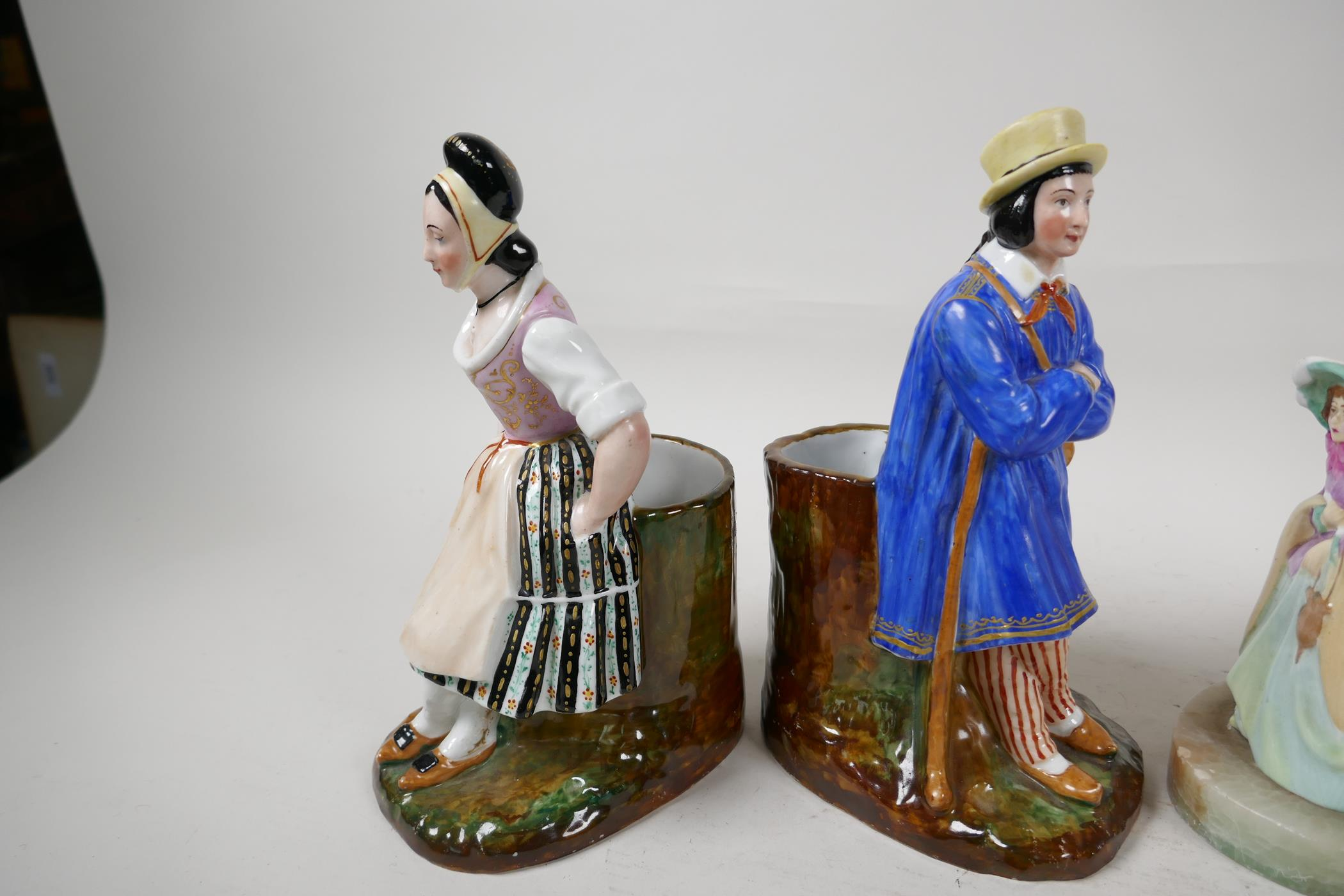 """A pair of continental porcelain spill vases modelled as a man and woman seated on tree stumps, 8½"""" - Image 5 of 6"""