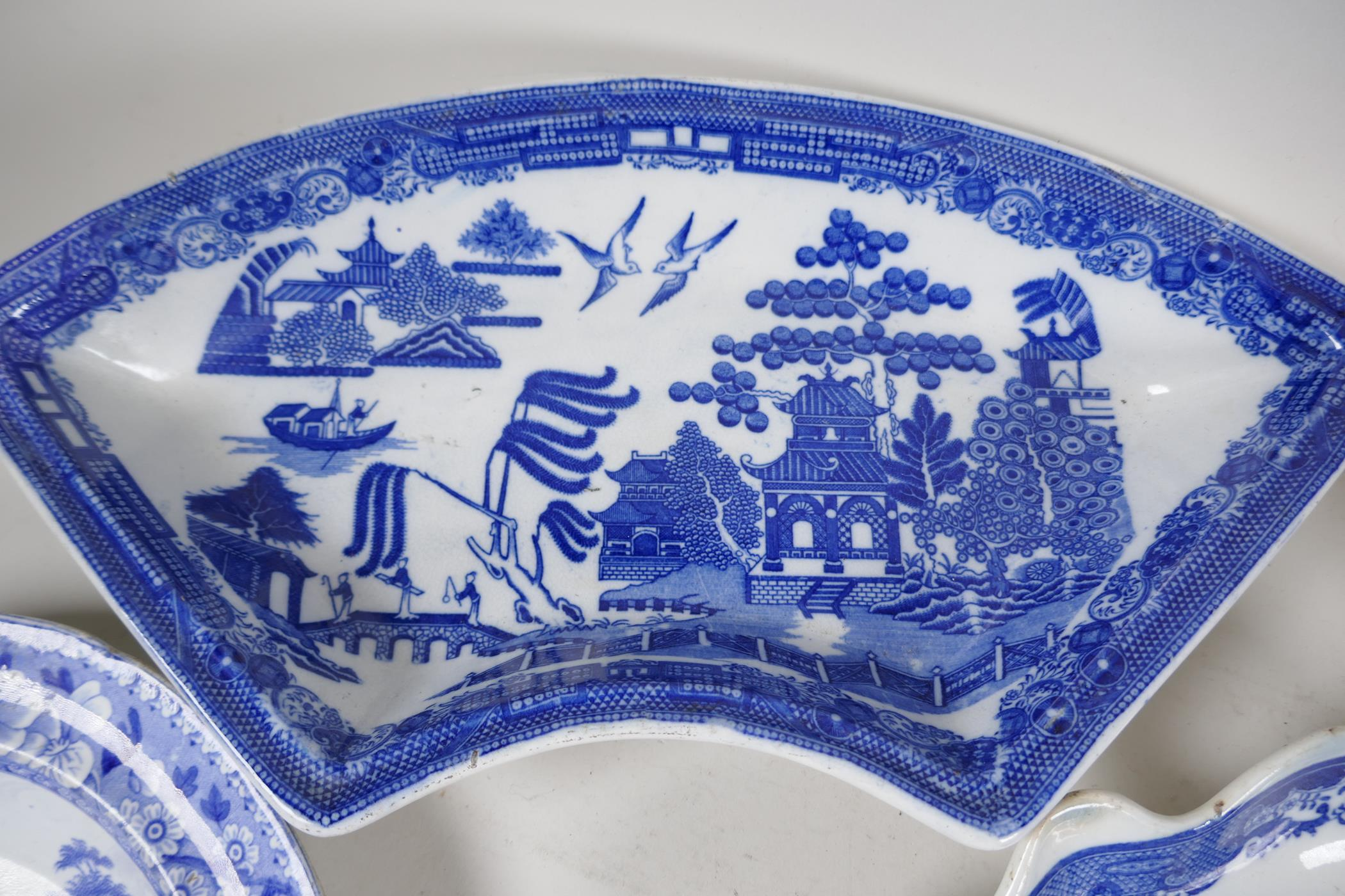 """A quantity of C19th blue and white pottery to include a crescent shaped tureen, 13"""" wide, a petal - Image 3 of 4"""
