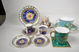 A Royal Worcester porcelain Millenium trio, two pin trays and a candleholder, an Aynsley