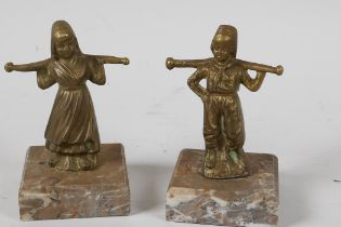 Two small brass/bronze figurines of Dutch Children, carrying yokes on their shoulders, mounted on