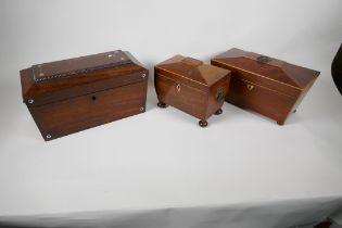 "Three C19th rosewood and mahogany Sarcophagus shaped tea caddies, largest 12½"" long"