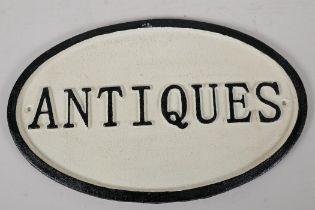 """A cast iron """"Antiques"""" sign, 13½ x 8½"""""""